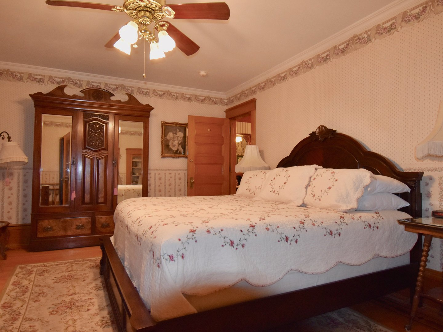 A bedroom with a bed and desk in a room at The Scofield House.