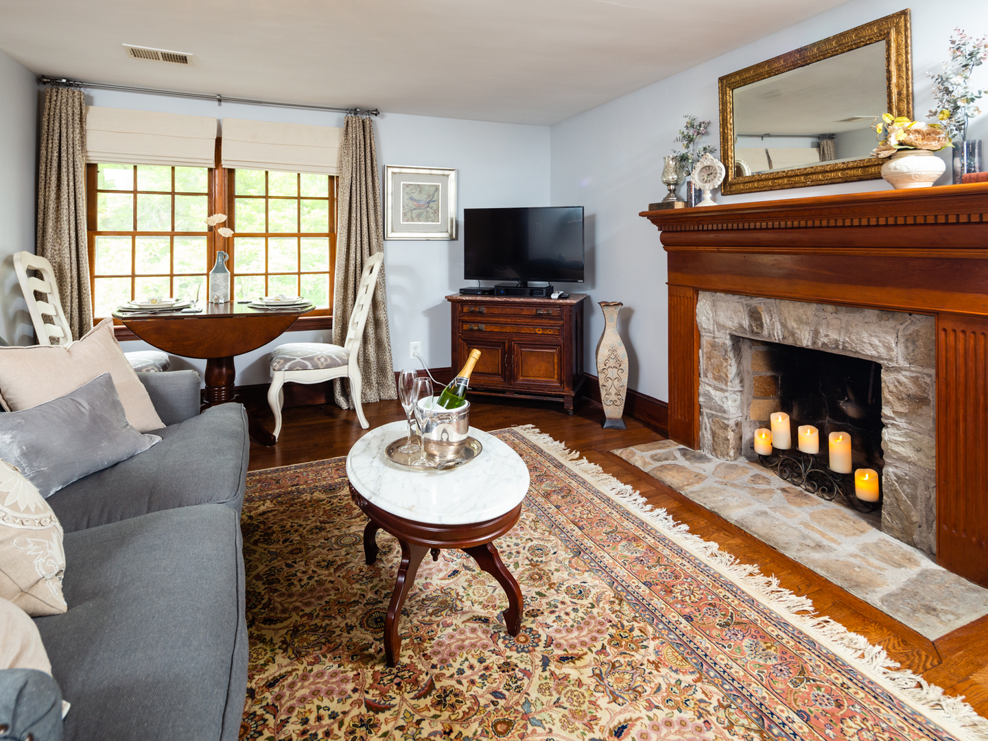 A living room filled with furniture and a fire place at Airwell Bed and Breakfast.
