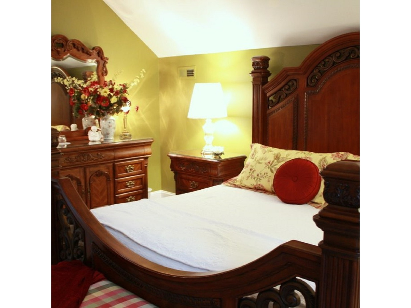 A bedroom with a bed and a chair in a room at Red Rocker Inn.
