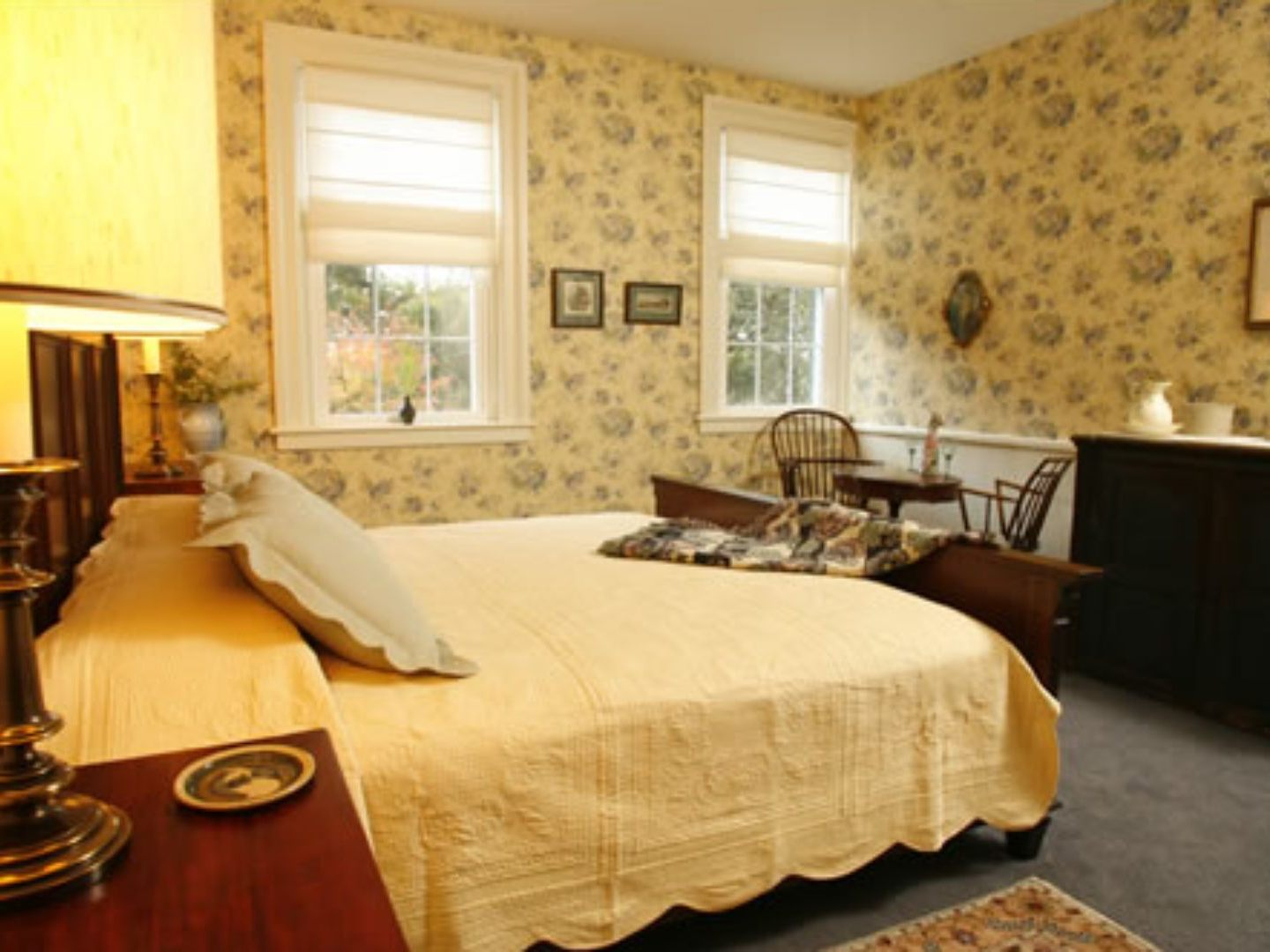 A bedroom with a bed and desk in a room at Temple Hill Bed & Breakfast.