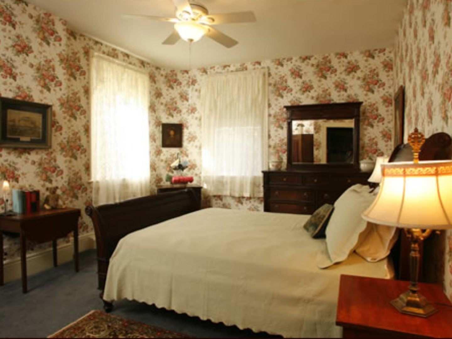 A hotel room with a bed and a fireplace at Temple Hill Bed & Breakfast.
