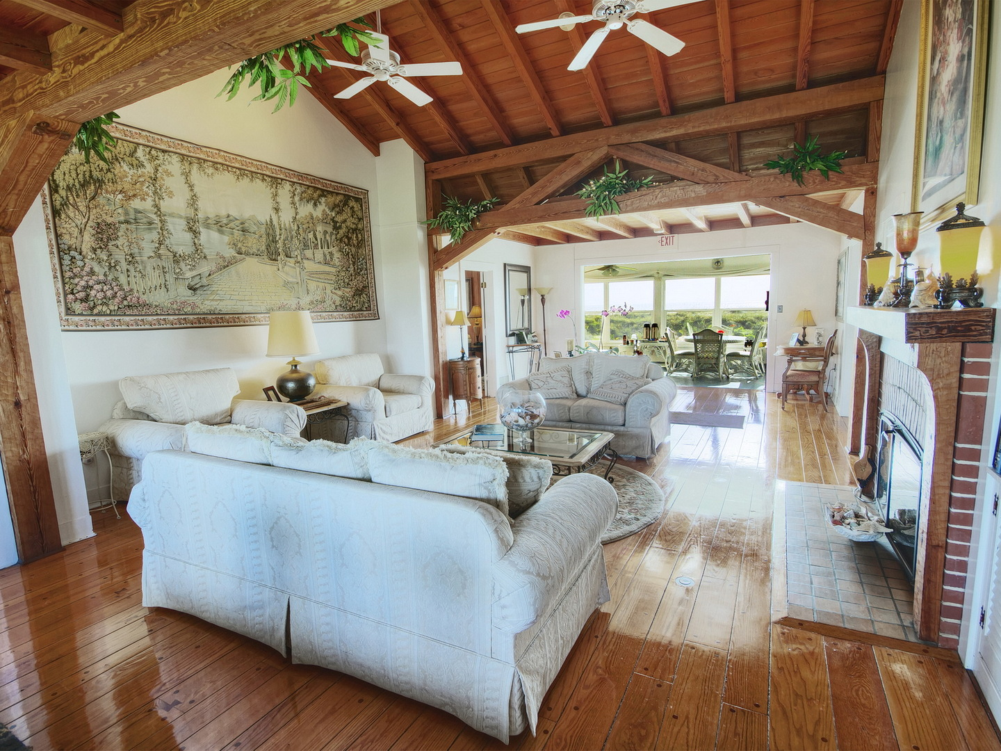 A living room filled with furniture and a fireplace at Beachfront Bed & Breakfast.