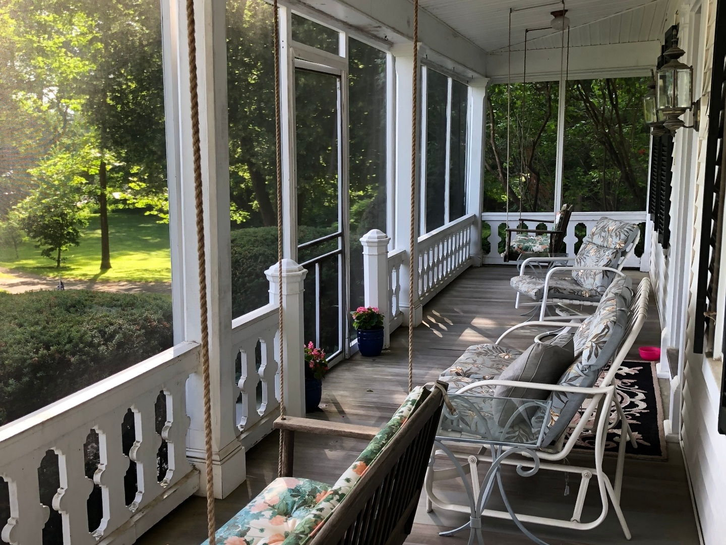 A group of porch at Aiken Manor Bed & Breakfast.