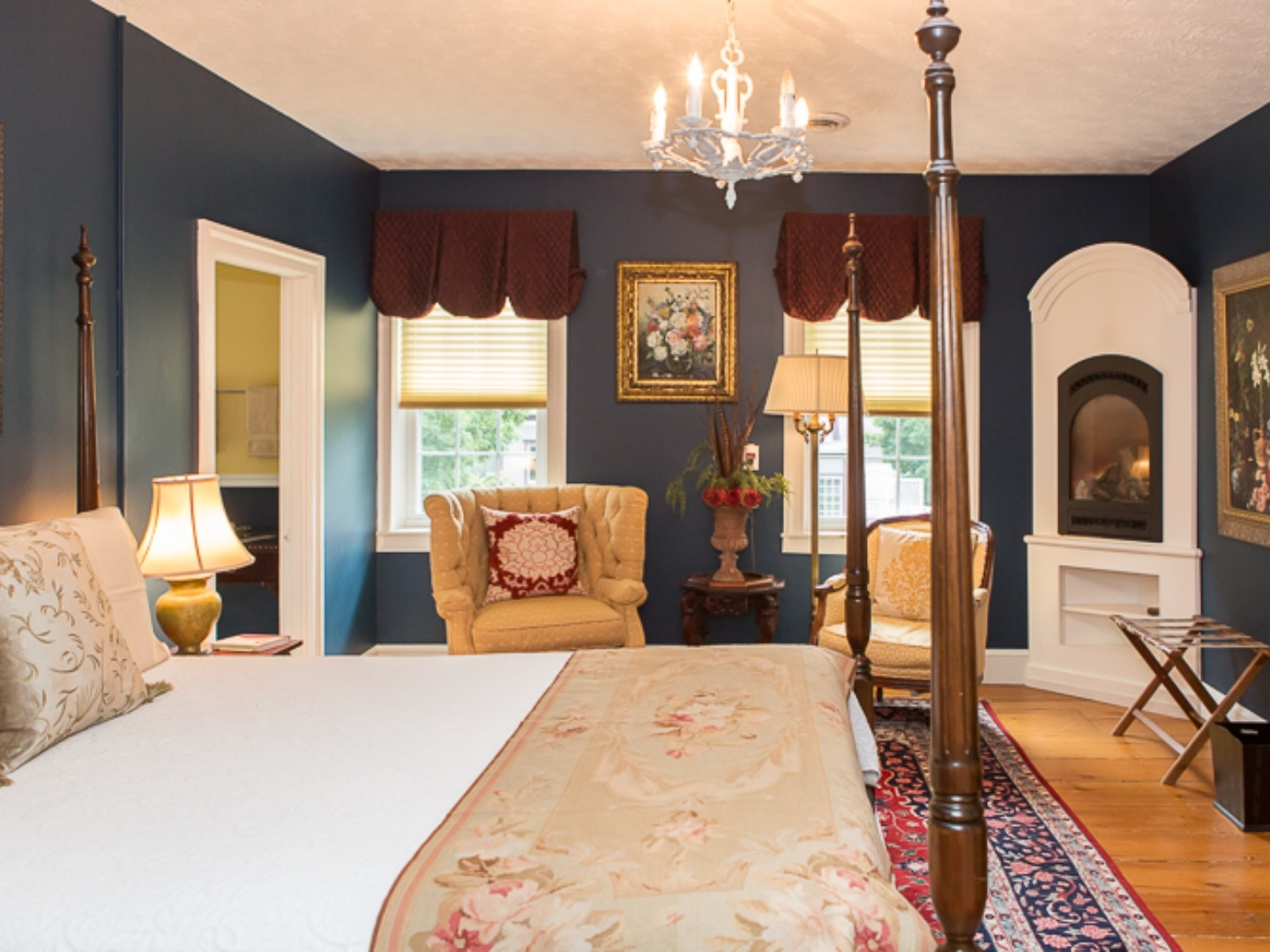 A bedroom with a bed and a table in a room at Monier Manor.