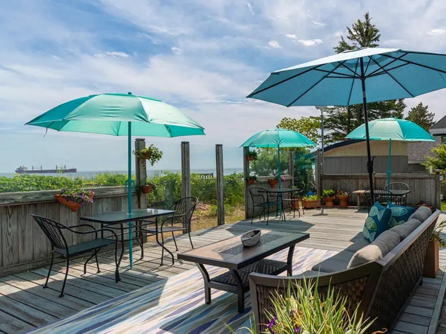 A green lawn chair with an umbrella at Solglimt Bed and Breakfast .