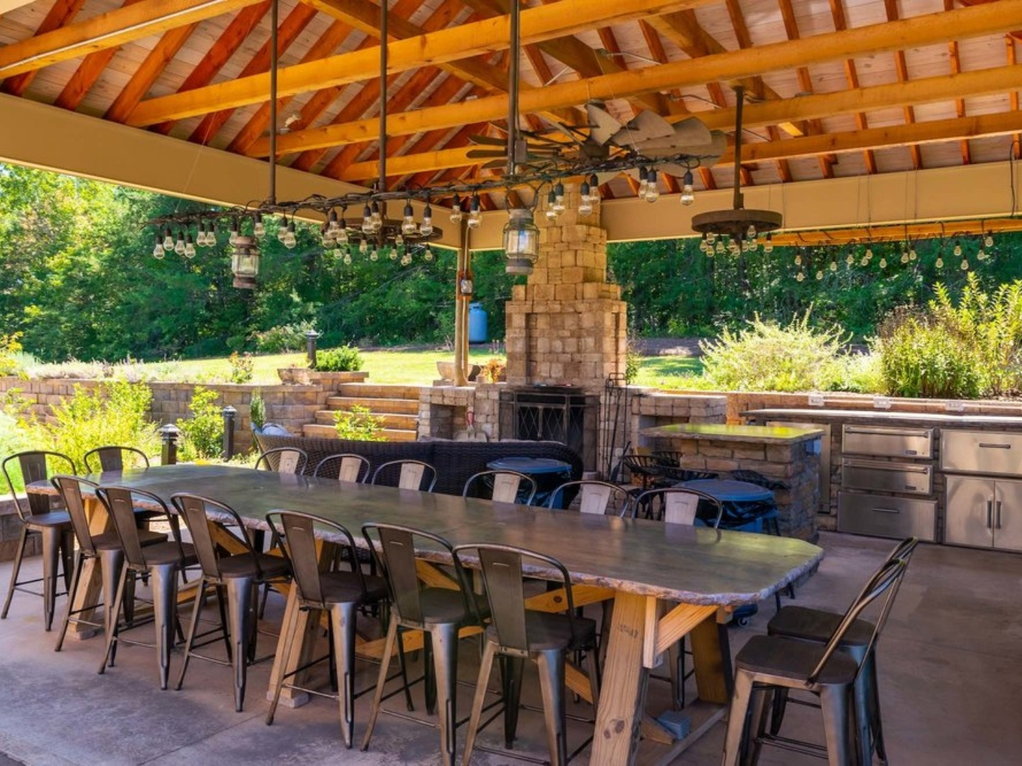 A group of people sitting at a table with an umbrella at Glassy View Bed and Breakfast.