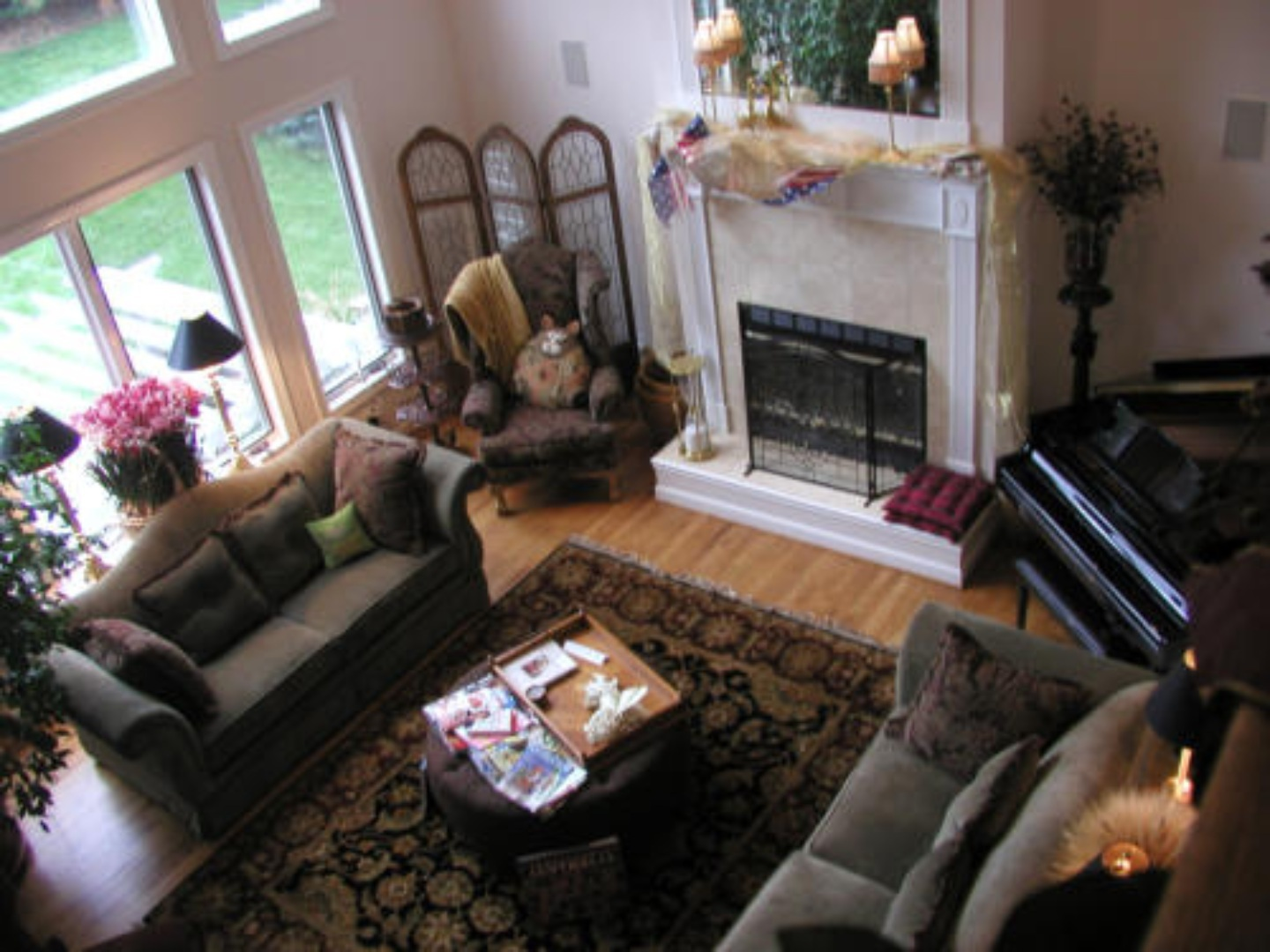A living room filled with furniture and a fire place at Canterbury Chateau Bed & Breakfast.