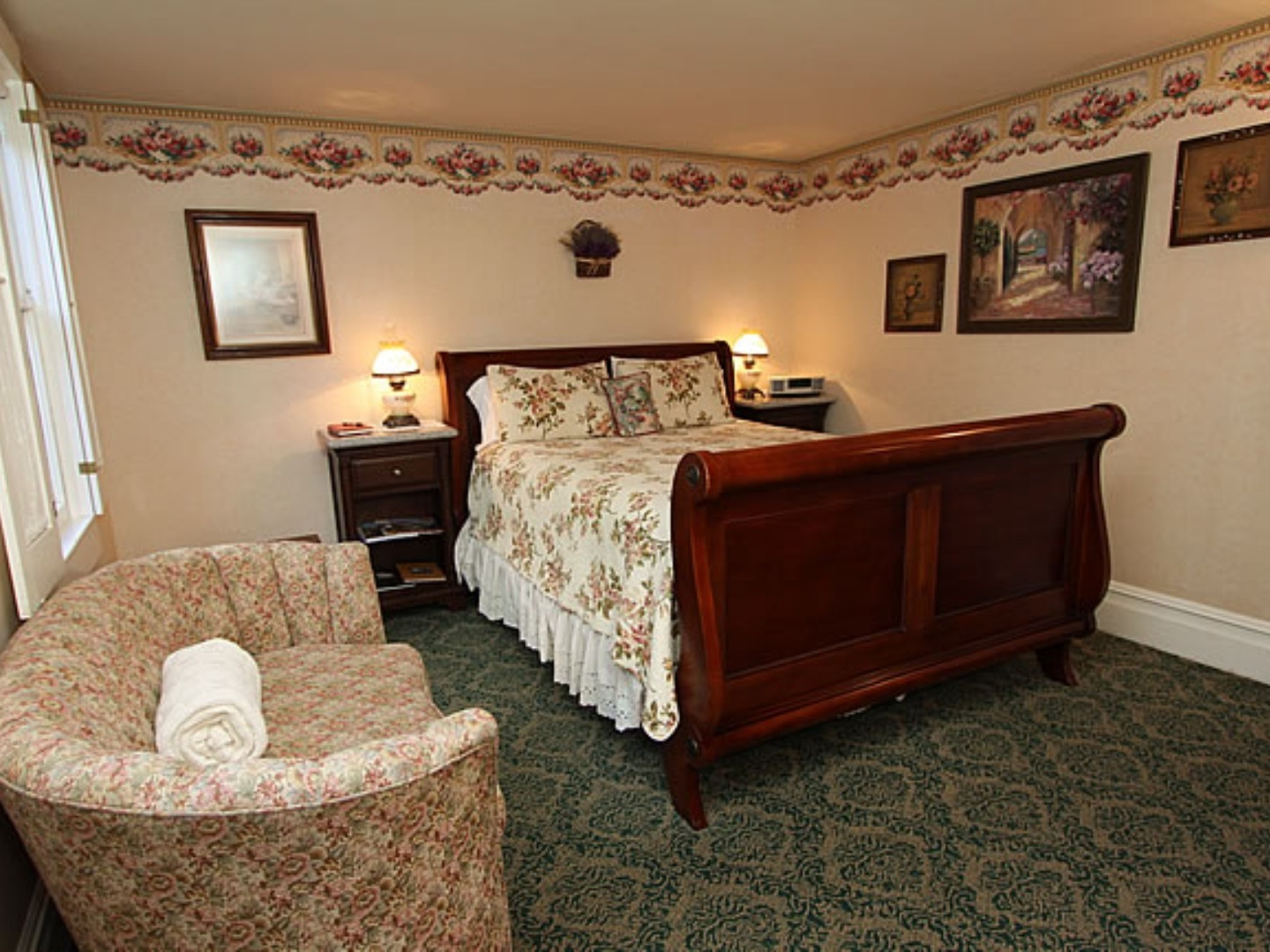 A bedroom with a bed and a couch in a living room at Raford Inn.