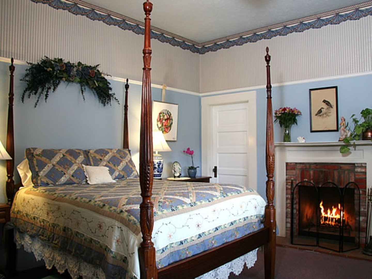 A bedroom with a bed and a fireplace at Raford Inn.
