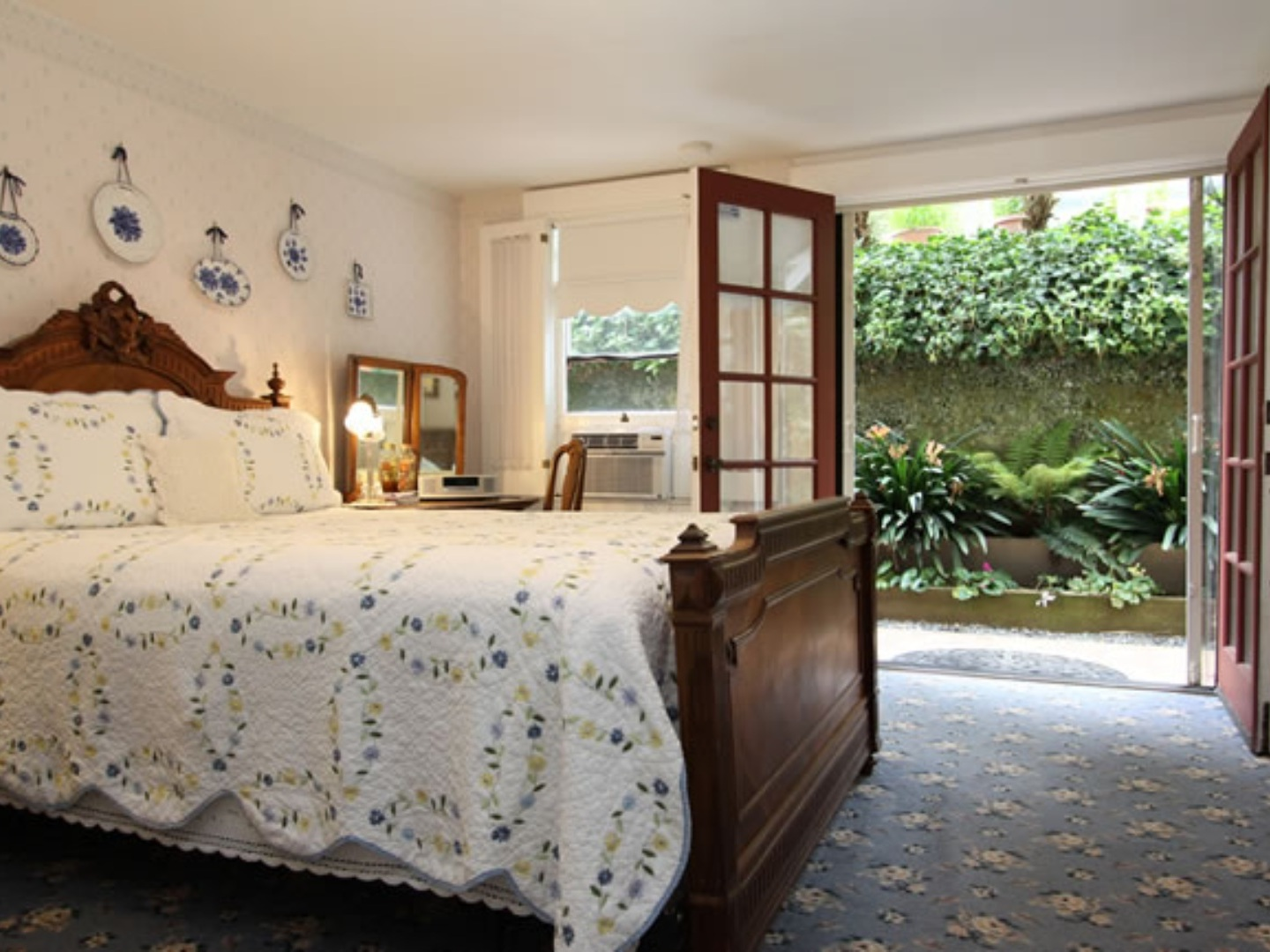 A bedroom with a large bed in a room at Raford Inn.