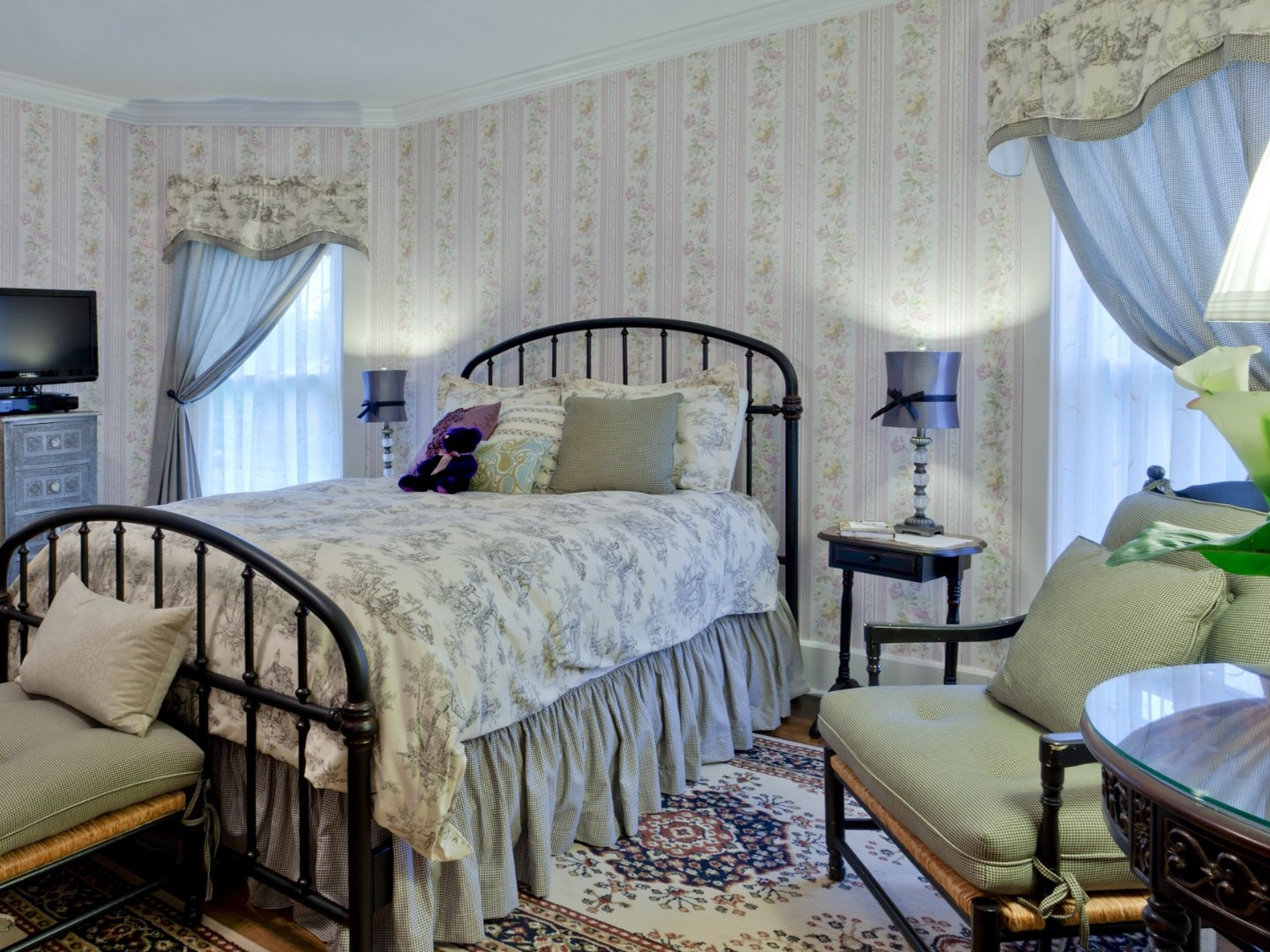 A bedroom with a bed and desk in a room at Garver House Bed and Breakfast.