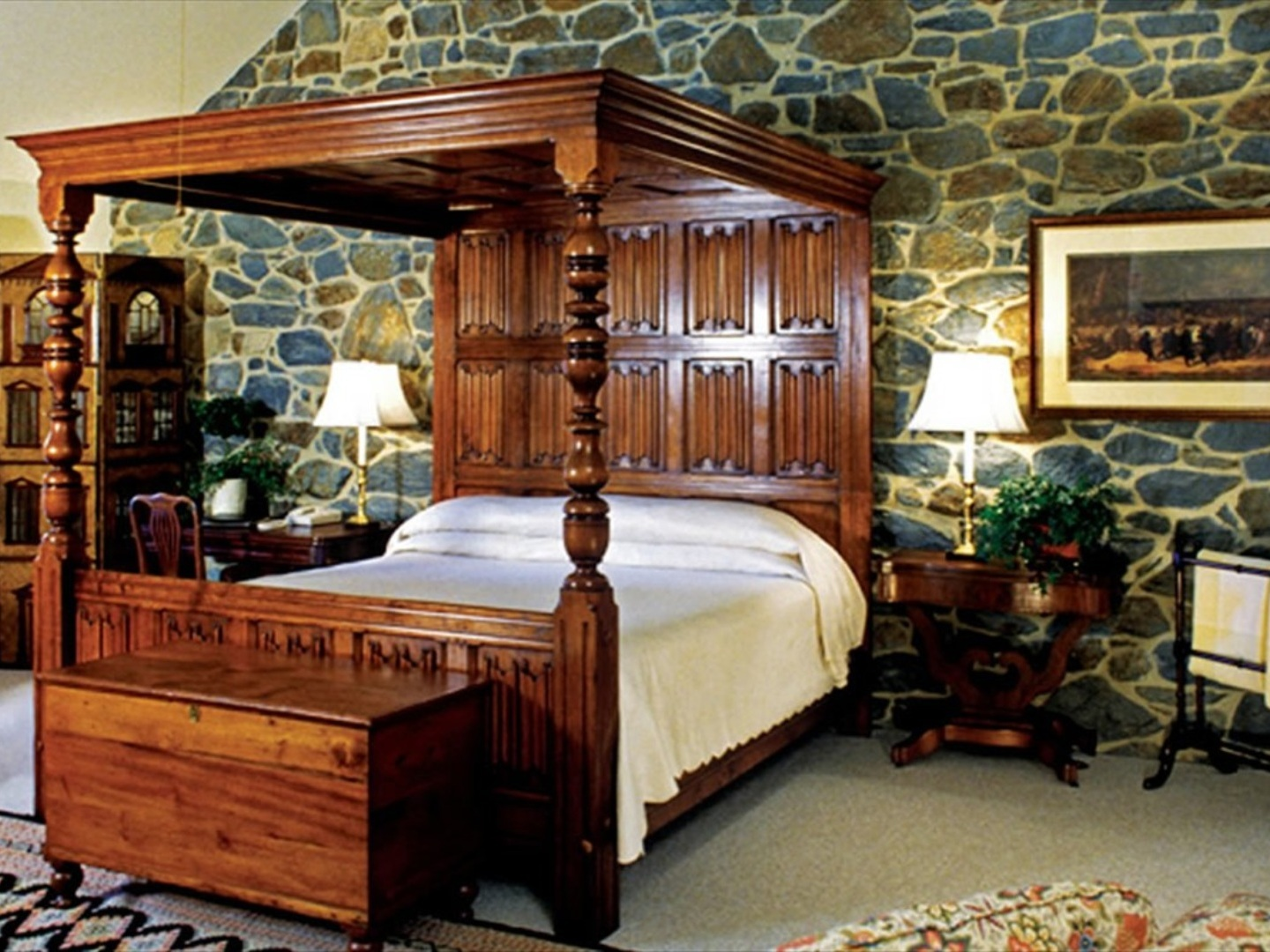 A bedroom with a bed and desk in a room at Inn at Montchanin Village & Spa.