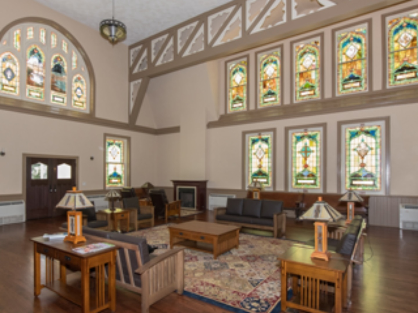 A living room filled with furniture and a large window at Tuxedo Park STL Bed & Breakfast Inn.