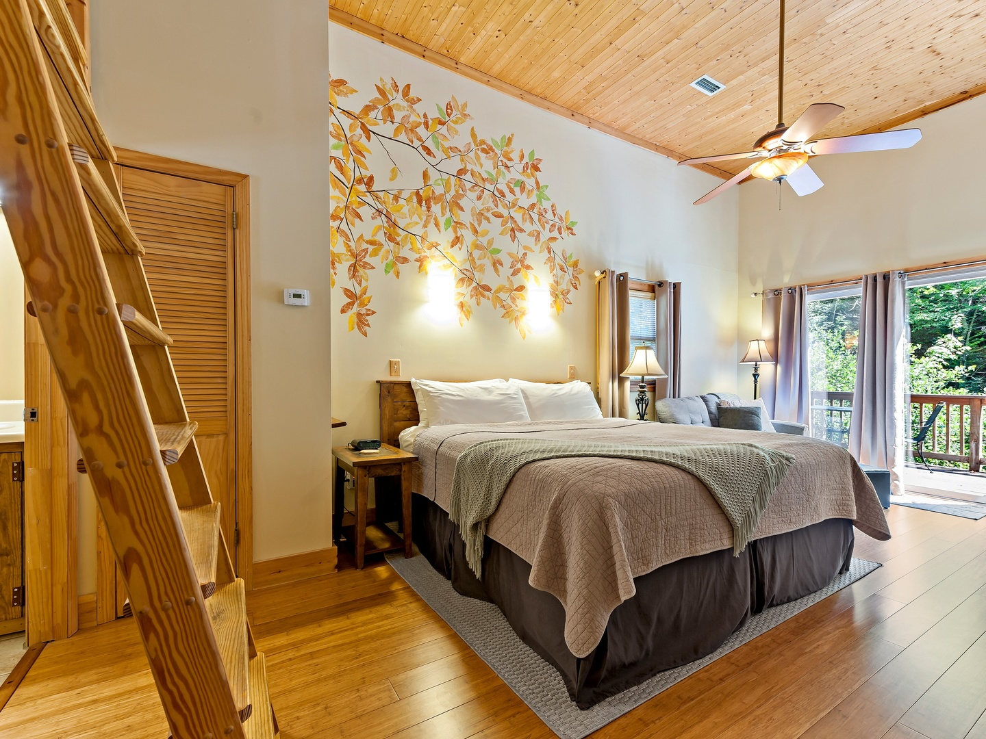A bedroom with a large bed in a room at Inn on Mill Creek.