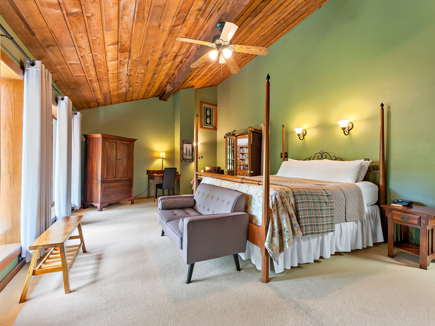 A bedroom with a bed and a chair in a room at Inn on Mill Creek.