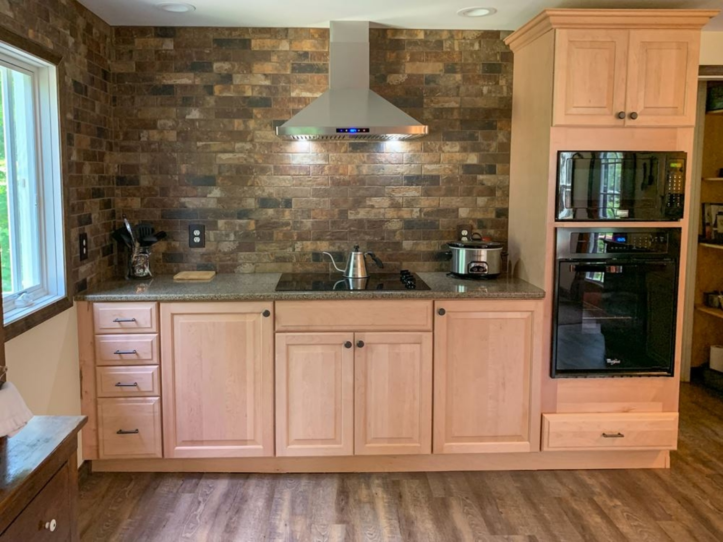 A large kitchen with stainless steel appliances and wooden cabinets at Red Fox Run Bed & Breakfast.