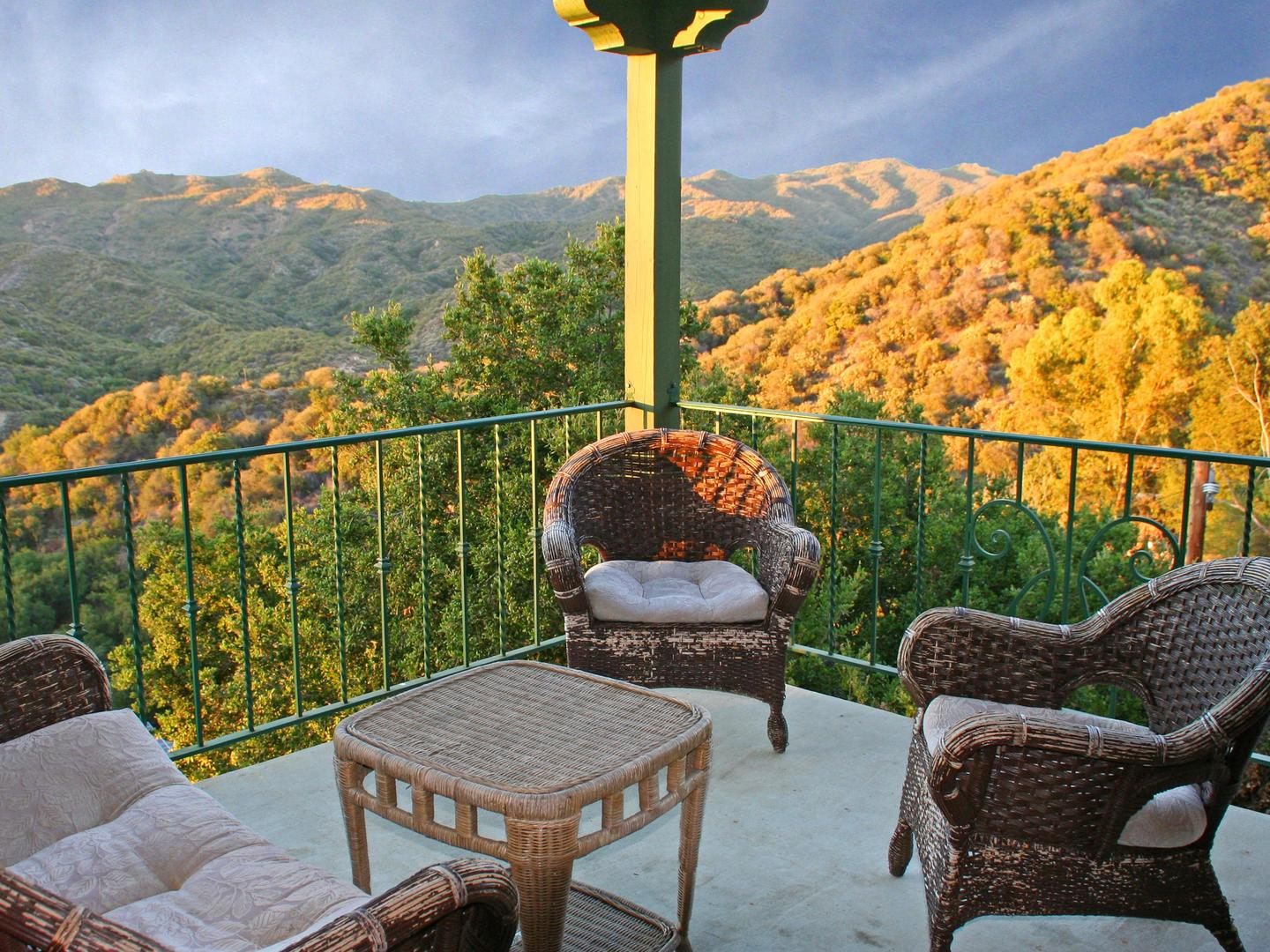 A view of a living room with a mountain in the background at Topanga Canyon Inn Bed and Breakfast.