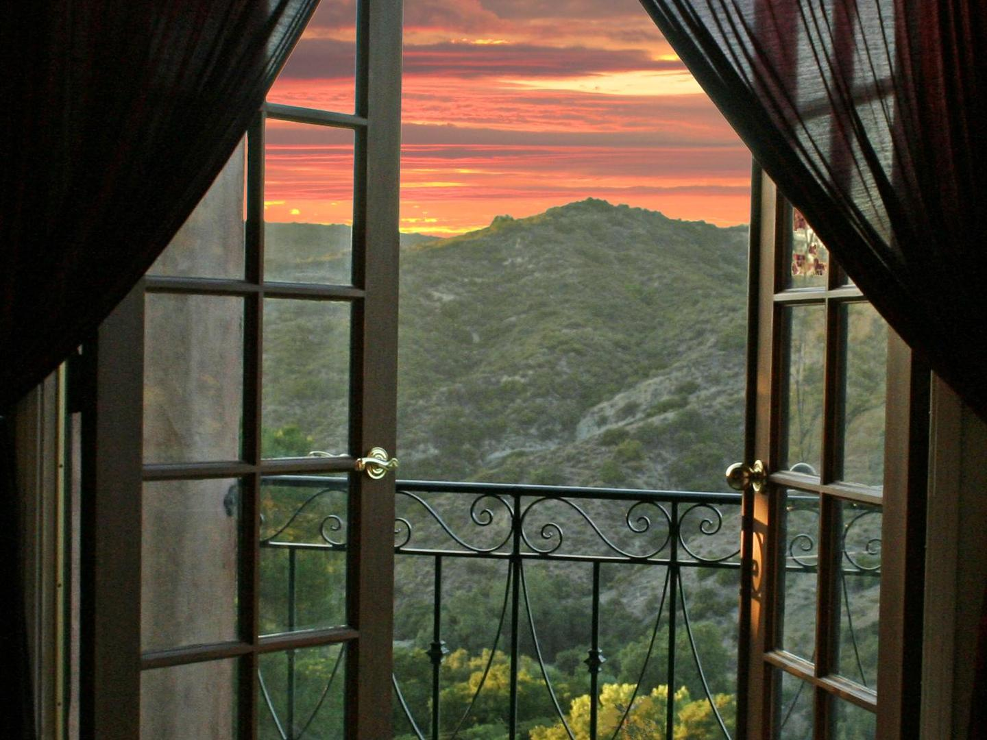 A view through a fence at Topanga Canyon Inn Bed and Breakfast.