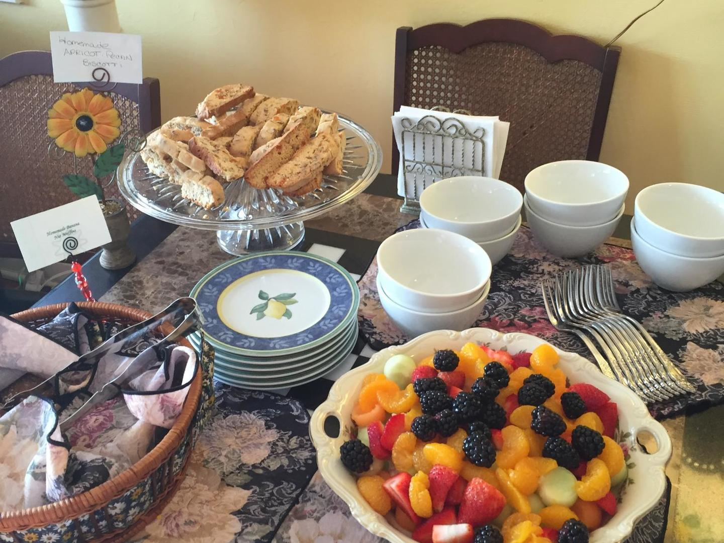 A table topped with plates of food on a plate at Sabal Palm House Bed and Breakfast Inn.