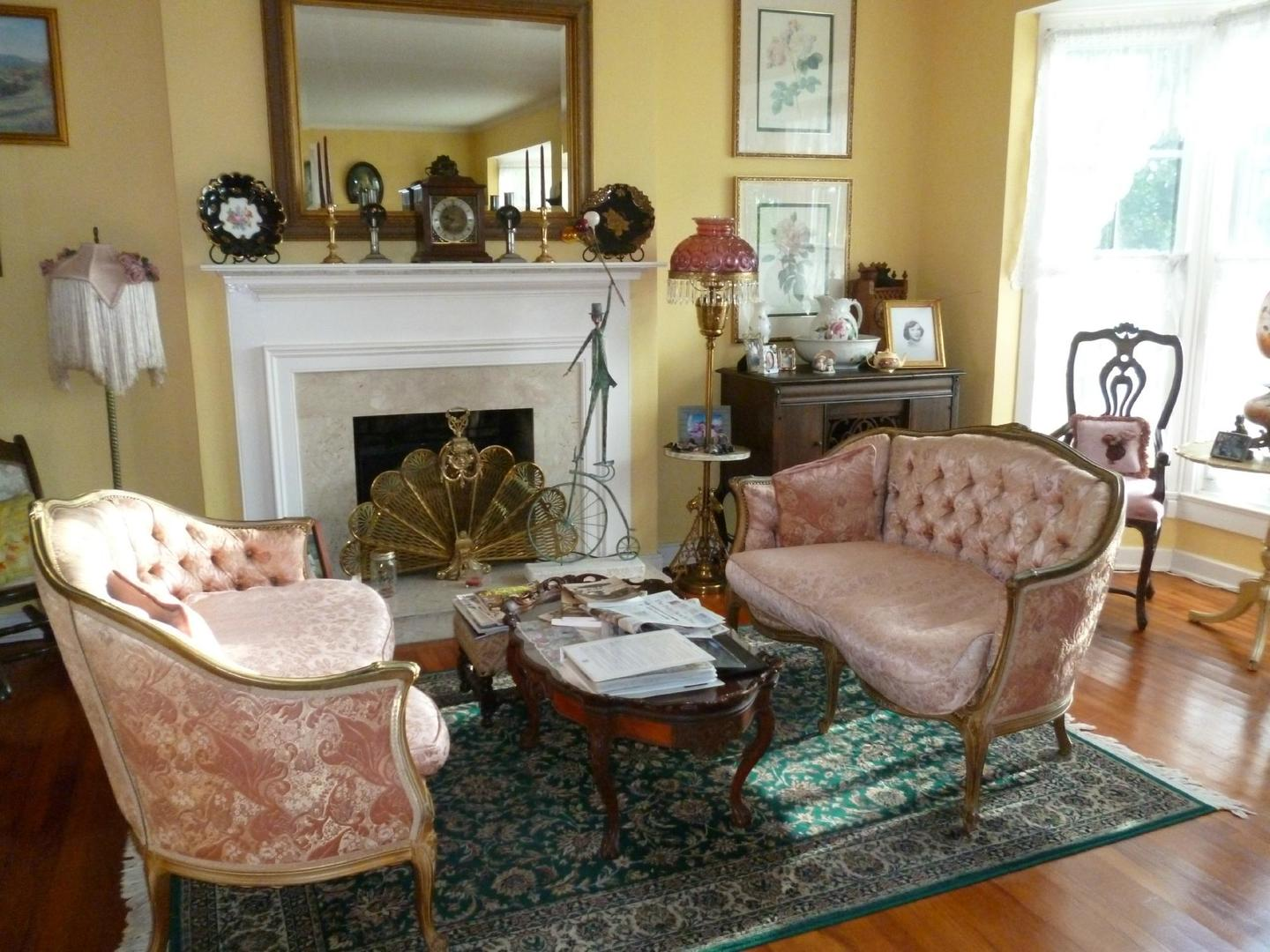 A living room filled with furniture and a fire place at Sabal Palm House Bed and Breakfast Inn.