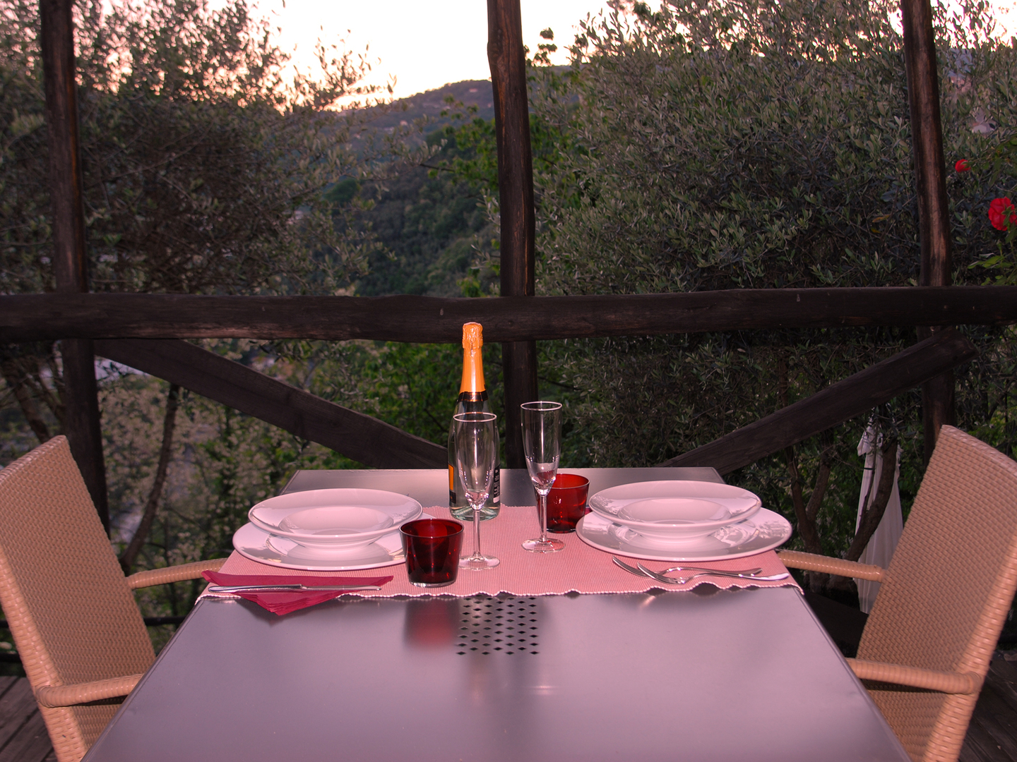 A glass of wine sitting on top of a picnic table at Villa Paggi country house.