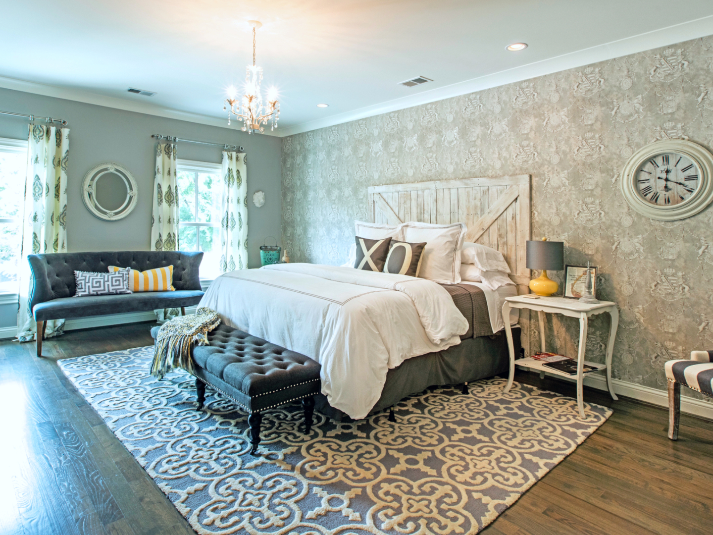 A bedroom with a bed and a chair in a room at Chateau Bourbon.