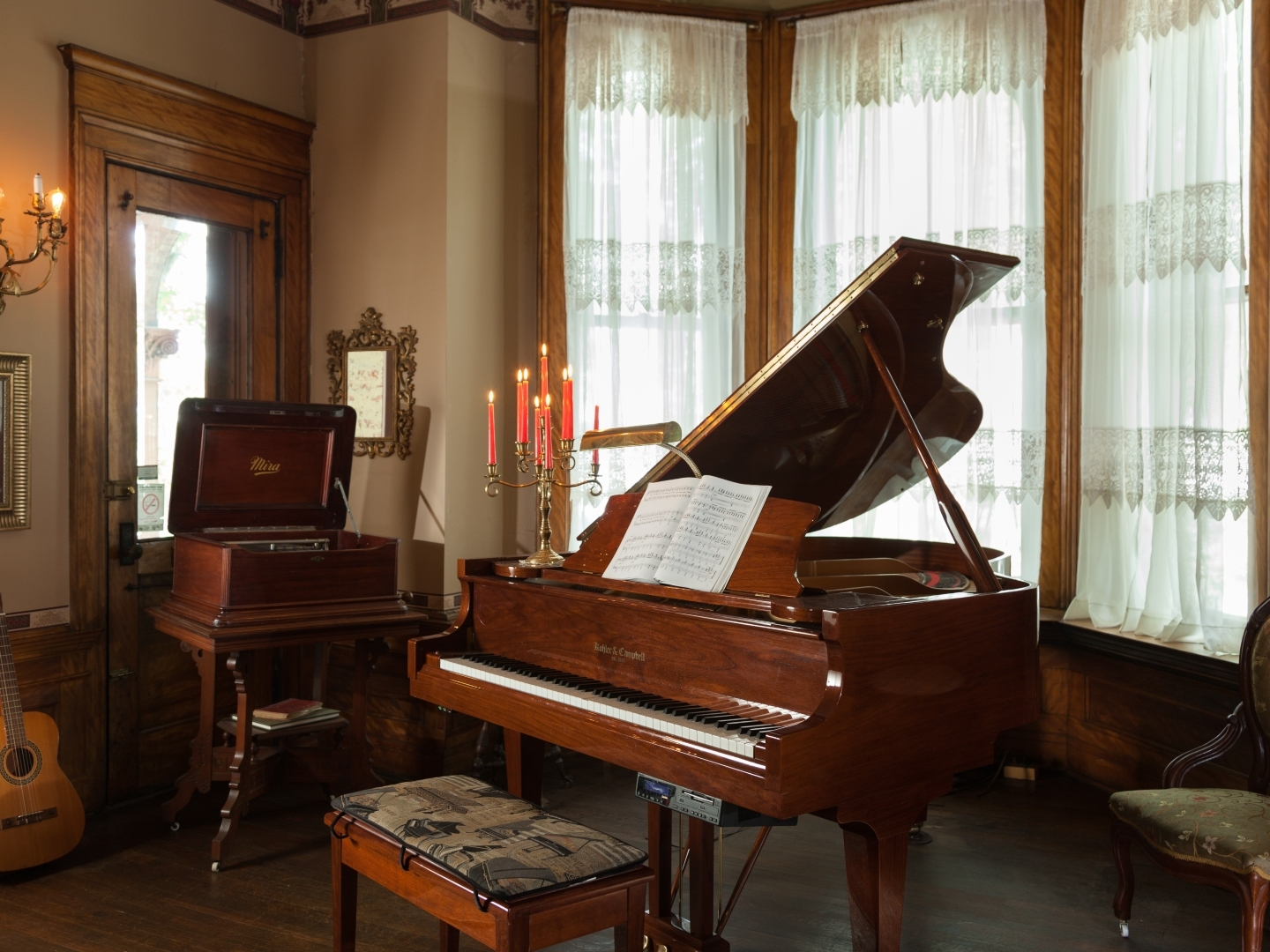 A laptop computer sitting on top of a piano at Vrooman Mansion.