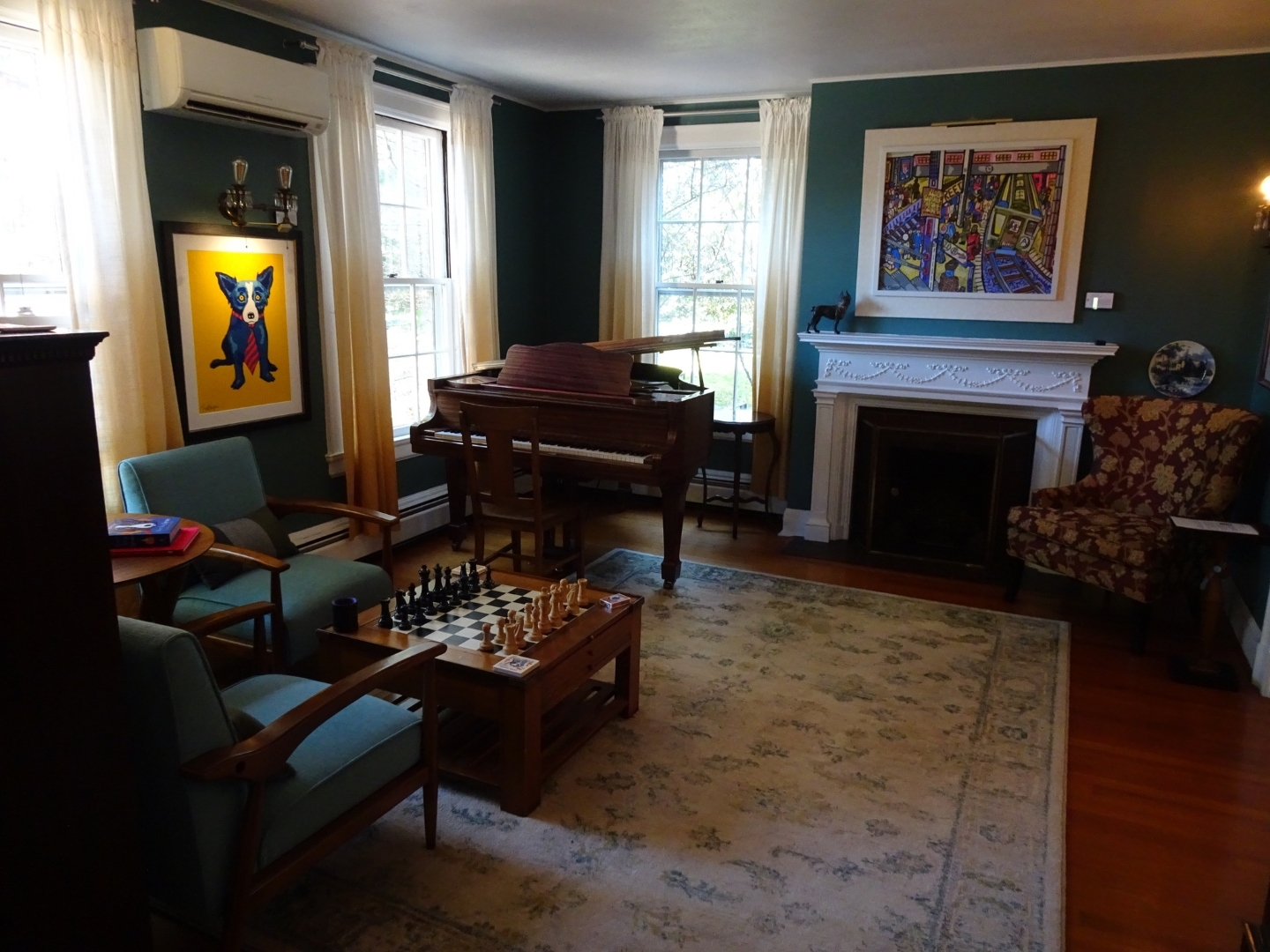 A living room filled with furniture and a large window at Applewood Manor.