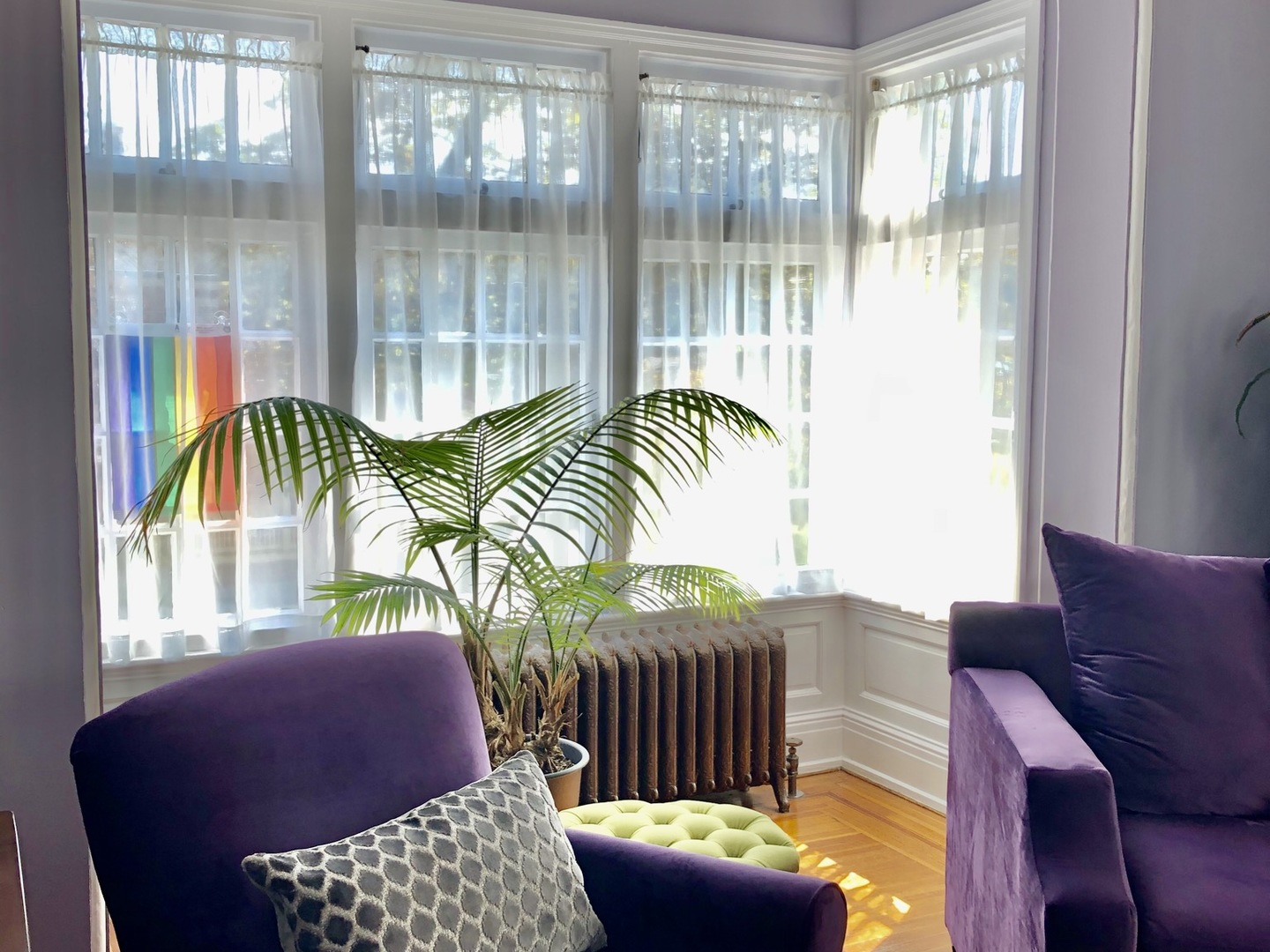 A living room filled with furniture and a large window at Himes House Bed & Breakfast.
