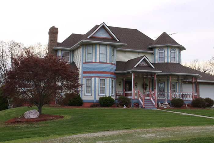 A large lawn in front of a house at Painted Lady Bed & Breakfast.