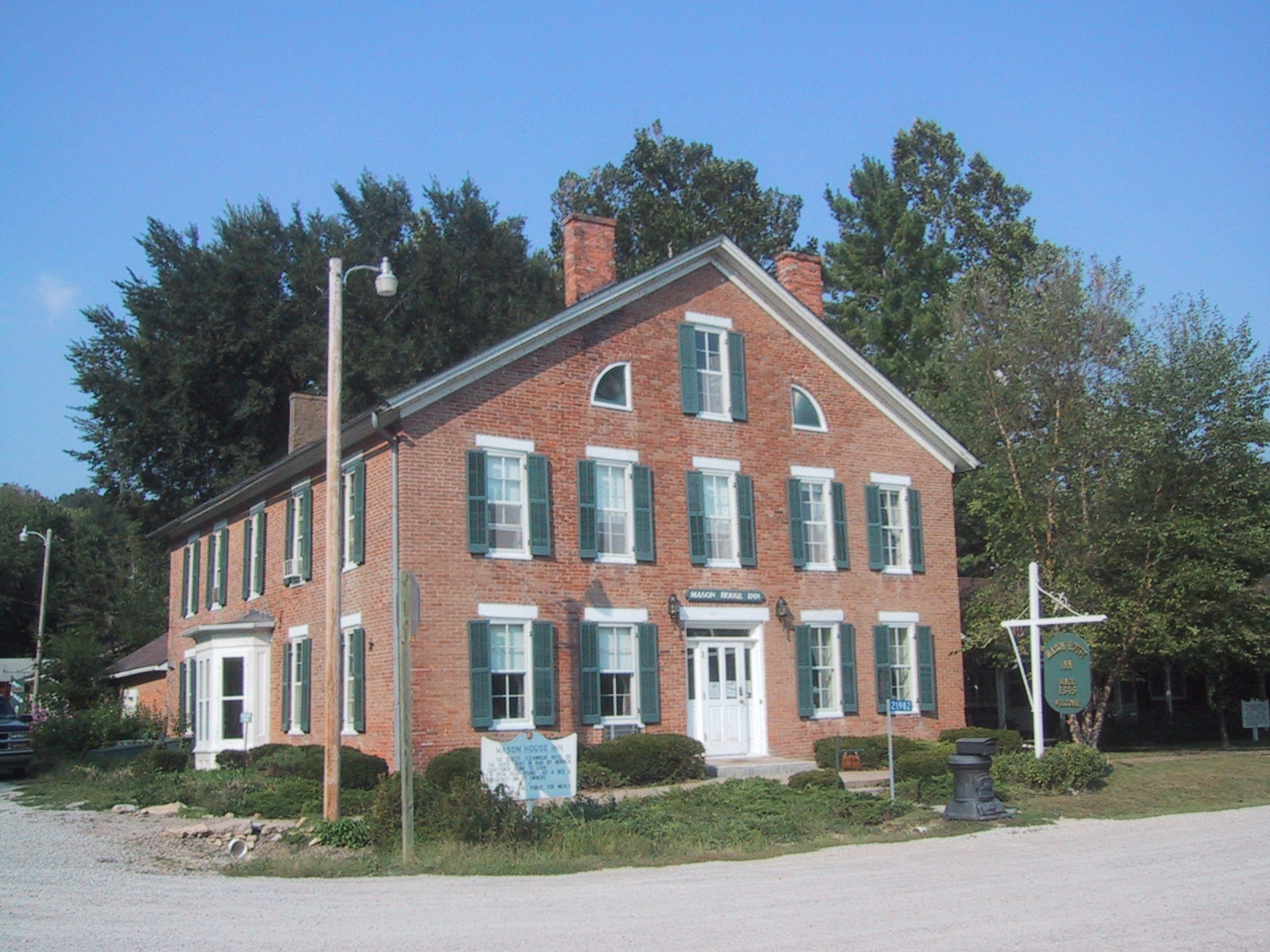A large brick building at Mason House Inn & Caboose Cottage.