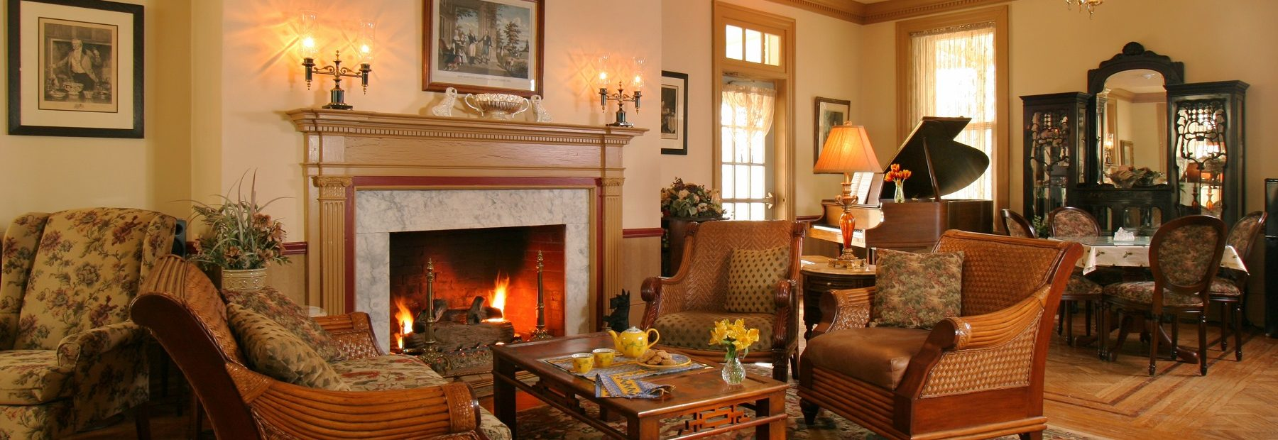 A living room filled with furniture and a fire place at Lafayette Inn.