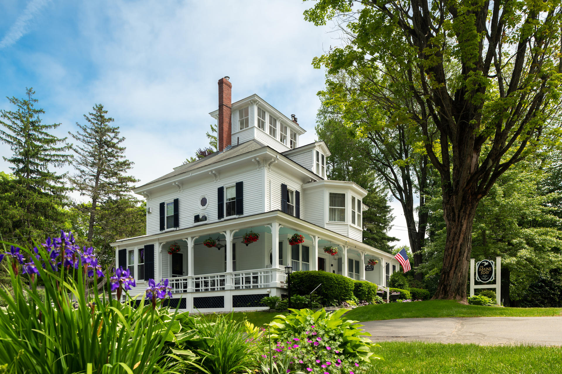 A large white house at Maine Stay Inn & Cottages.