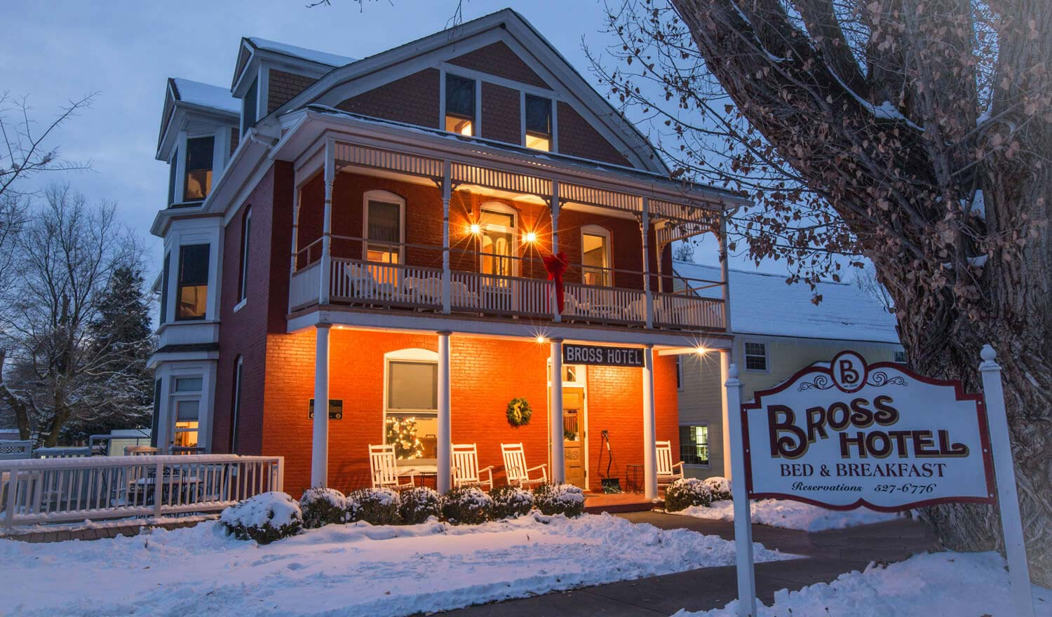 A house covered in snow at Bross Hotel Bed & Breakfast.