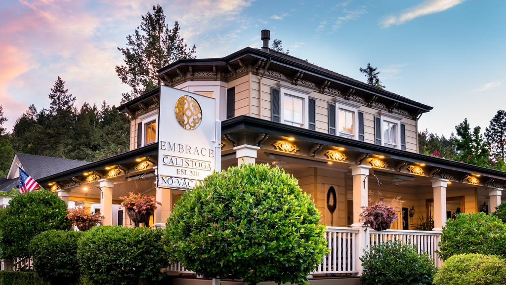A small clock tower in front of a house at Embrace Calistoga.