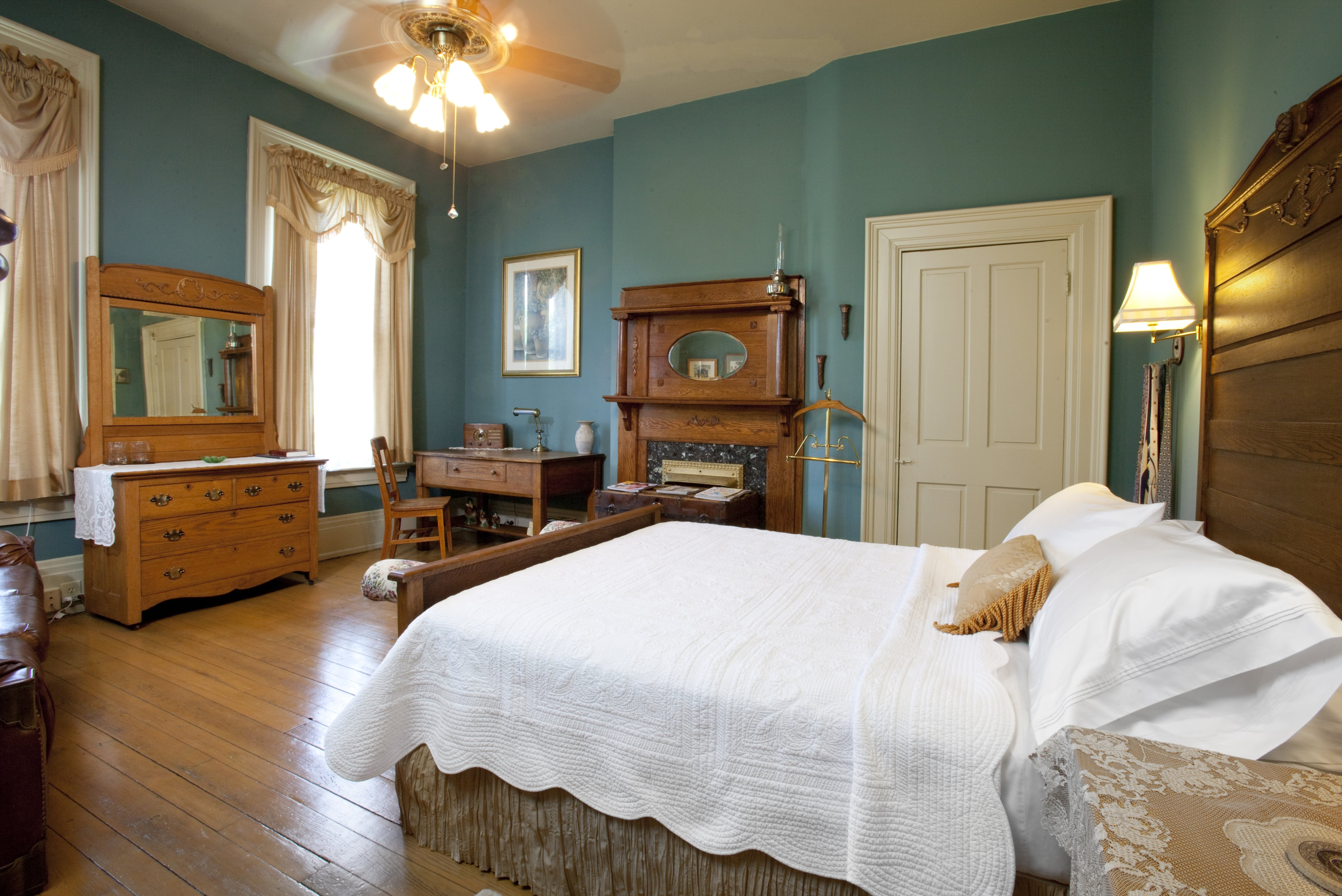 A bedroom with a large bed in a room at Gateway Bed and Breakfast.