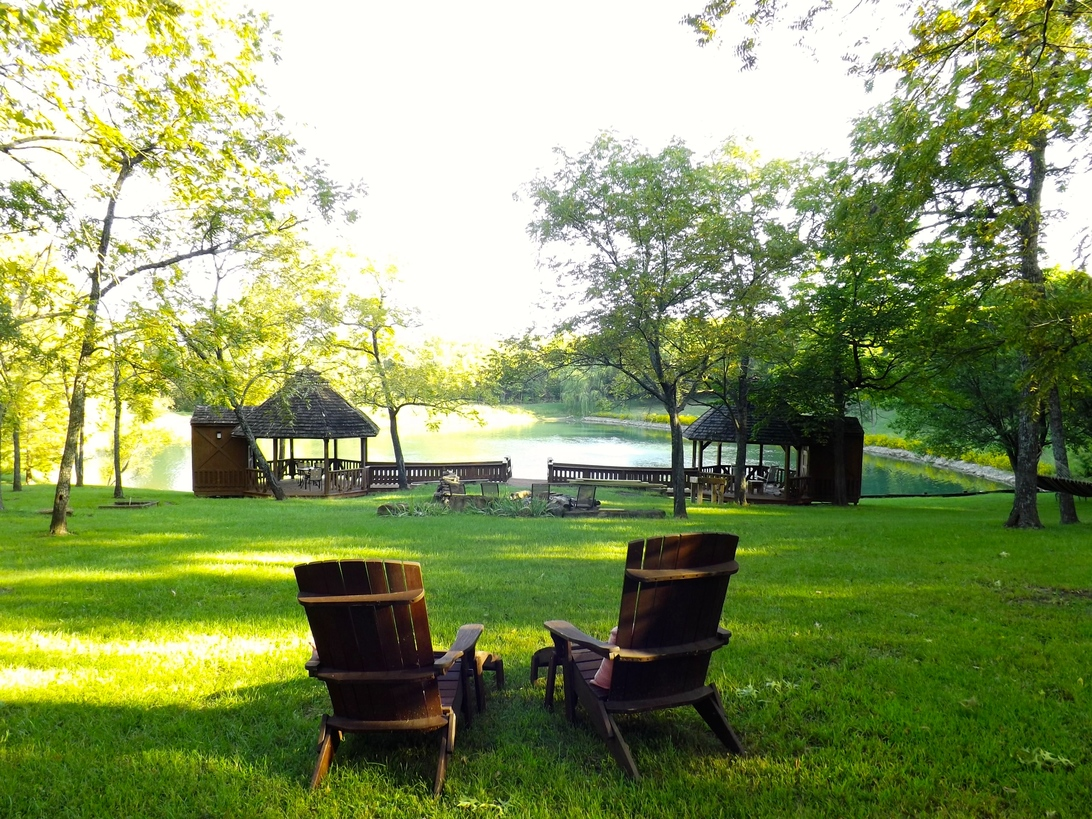 A couple of lawn chairs sitting on top of a bench in a park at Walnut Waters Bed and Breakfast.