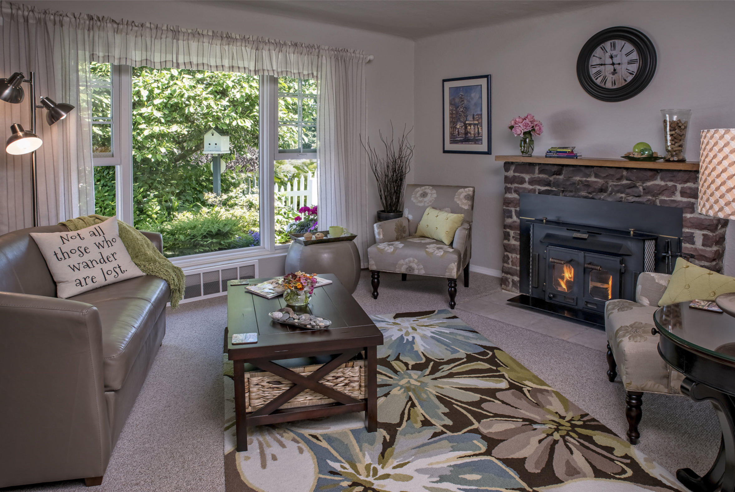 A living room filled with furniture and a fire place at The Guest House Bed & Breakfast.