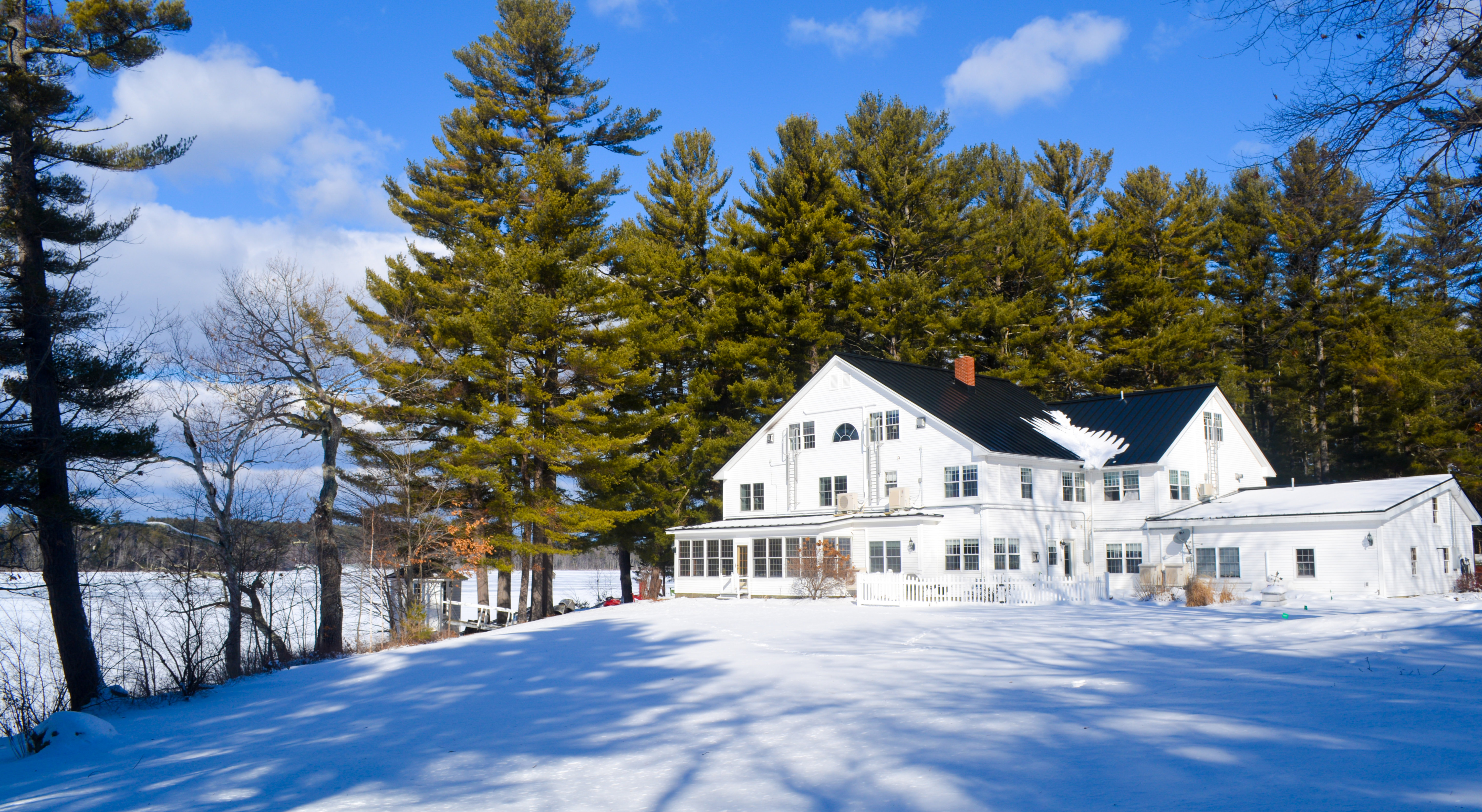 A house covered in snow at Wolf Cove Inn.