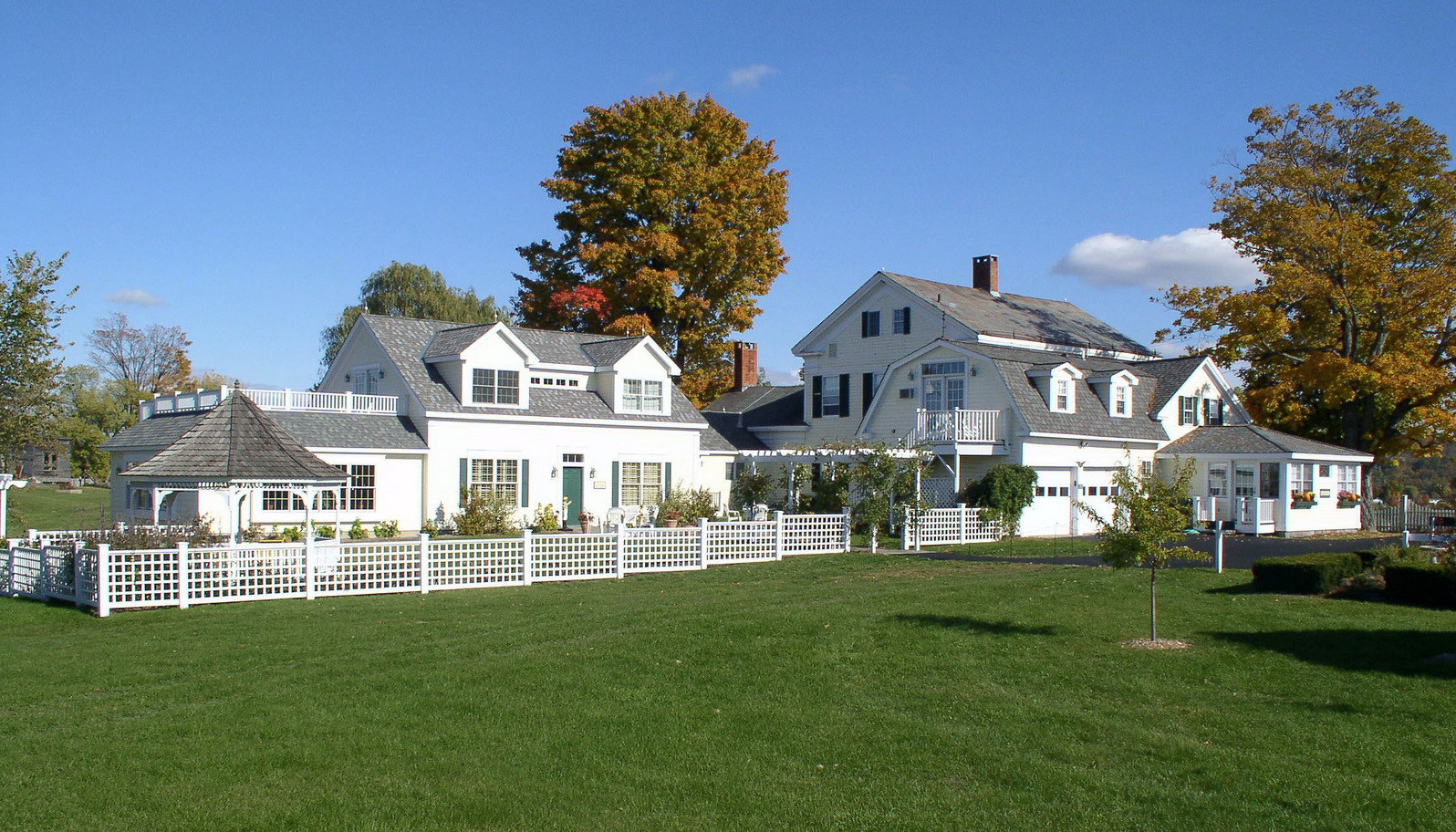 A large lawn in front of a house at Strong House Inn.