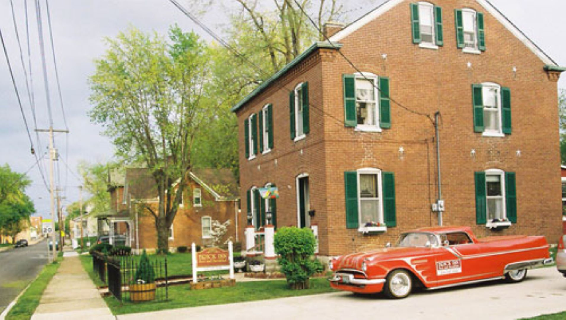 A car parked on the side of a building at Brick Inn Bed and Breakfast.