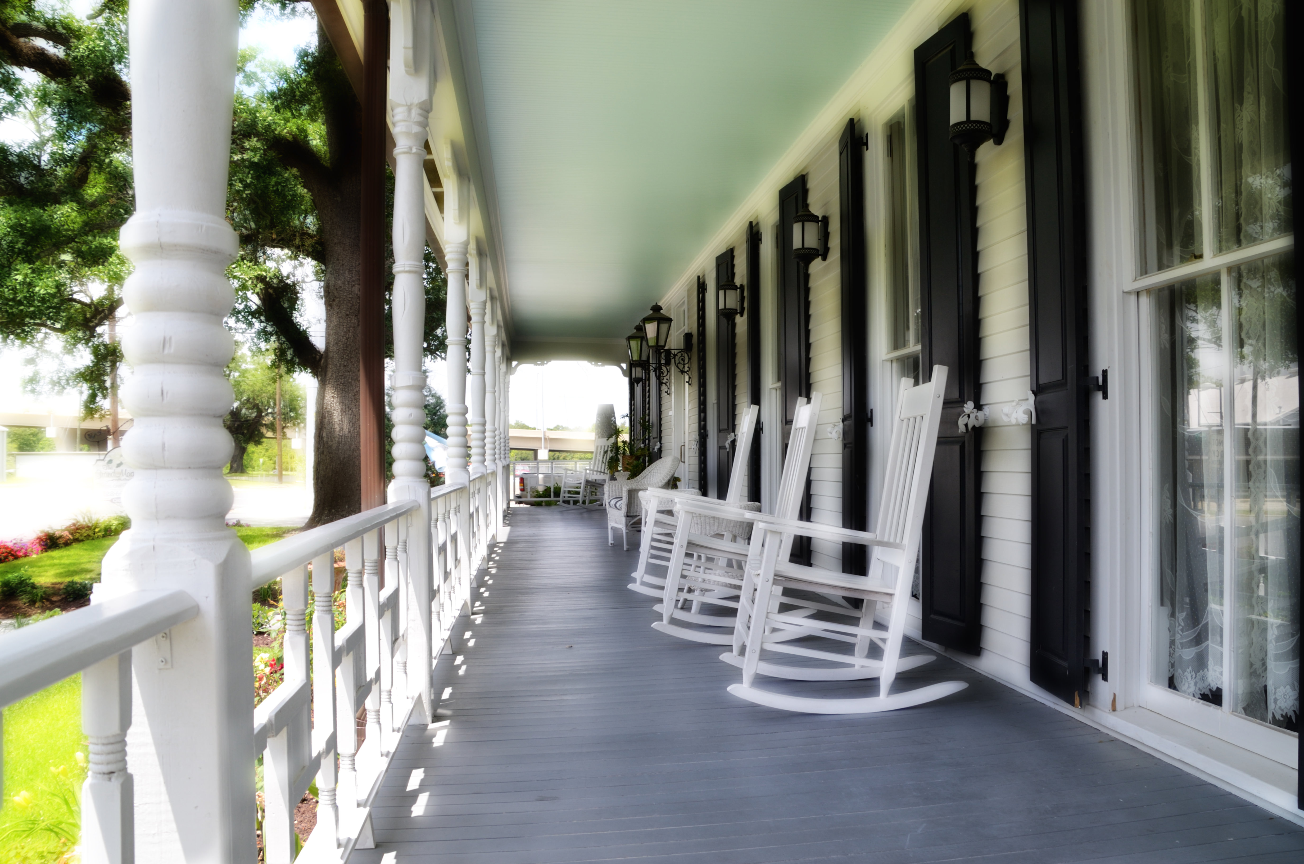 A chair sitting in front of a building at The Grand Magnolia Ballroom & Suites.