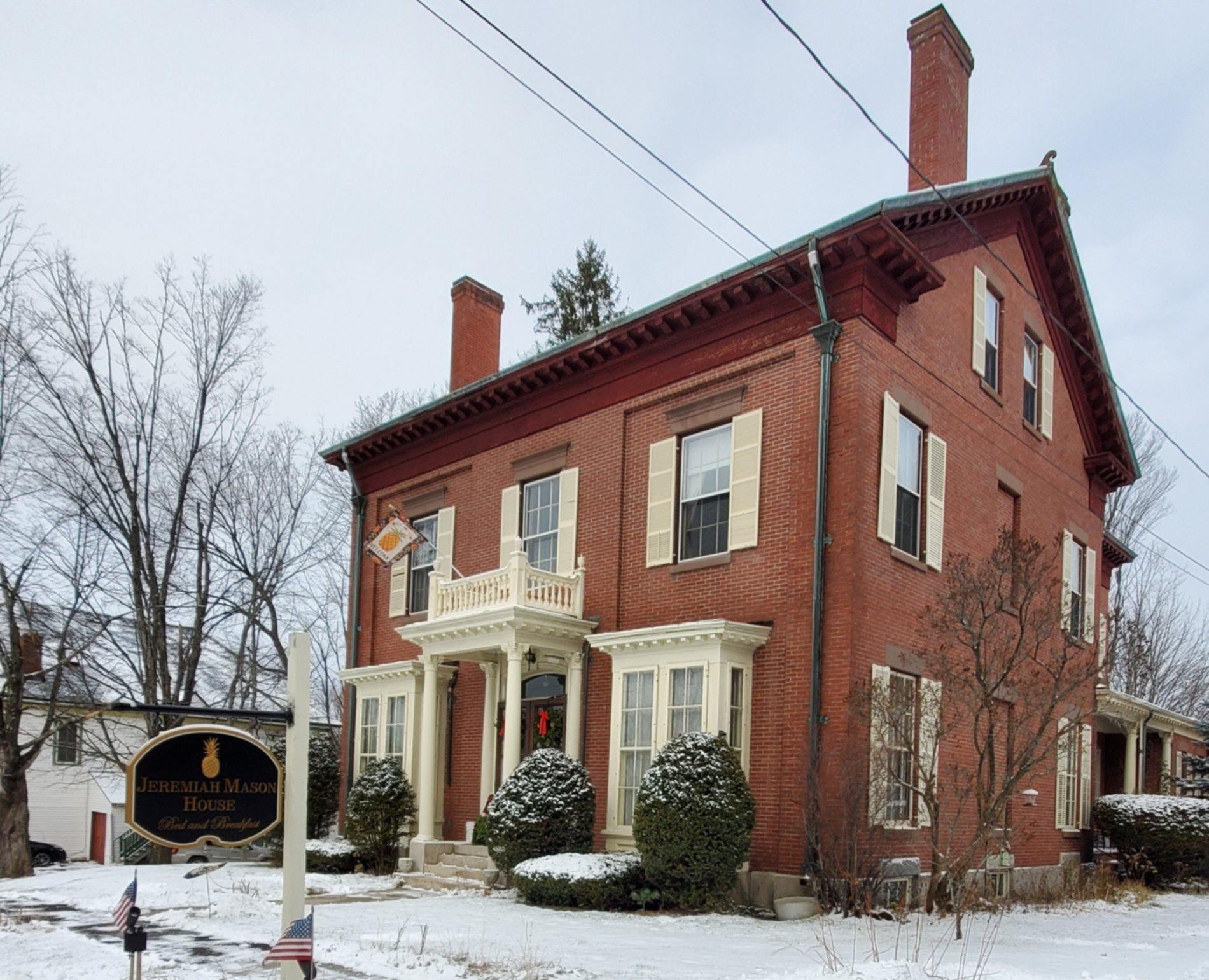 A house covered in snow at The Jeremiah Mason House Bed and Breakfast.
