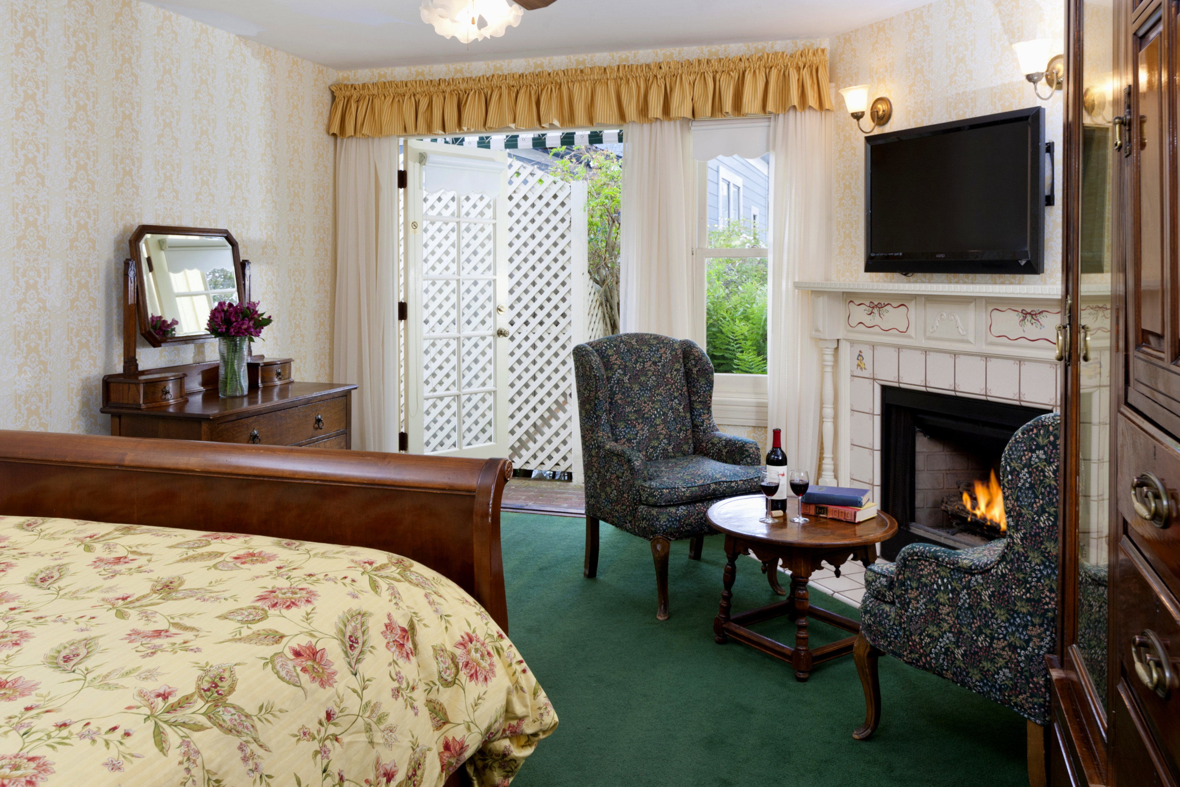 A living room filled with furniture and a fire place at Gosby House Inn, A Four Sisters Inn.
