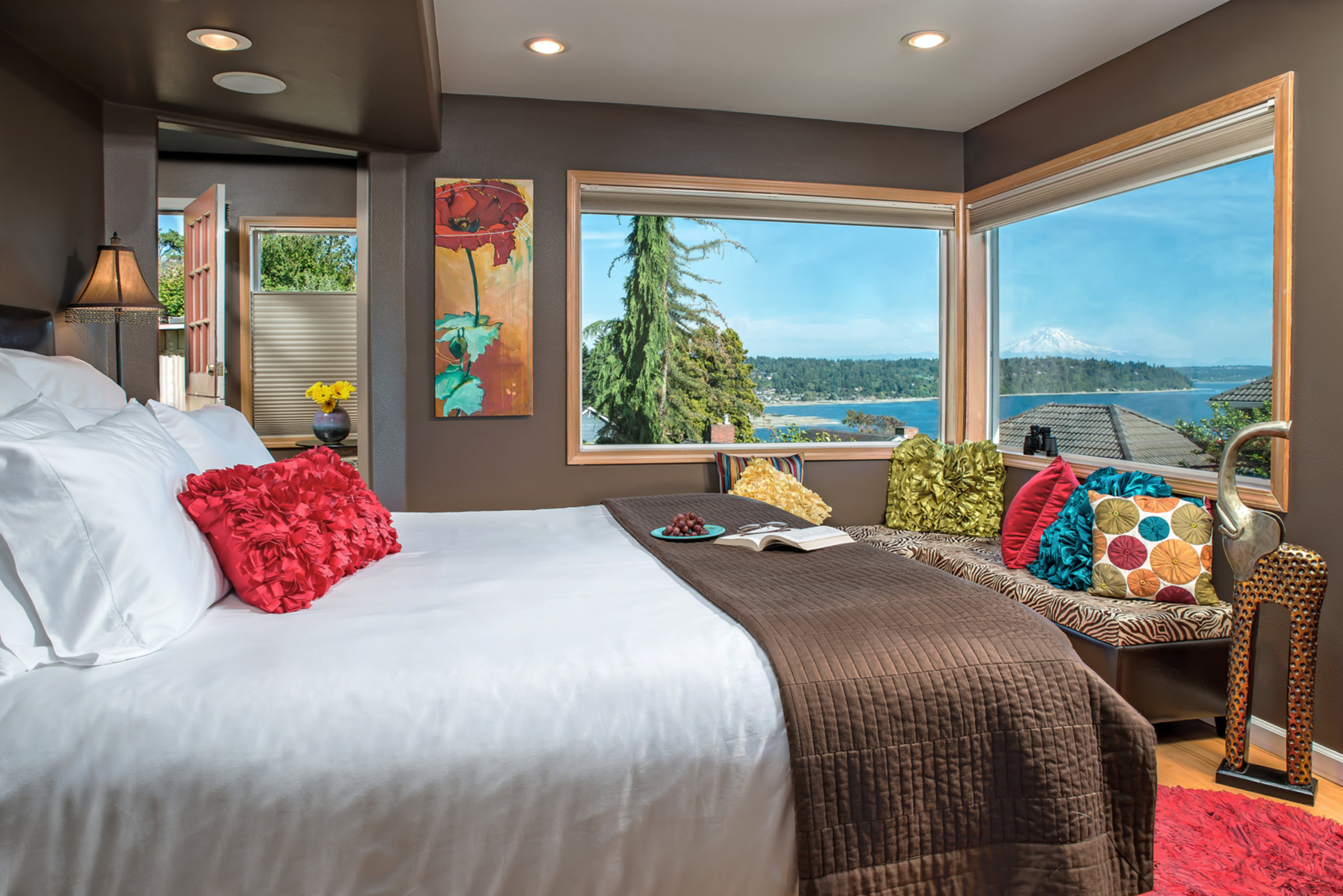 A bedroom with a bed and a window at Three Tree Point Bed & Breakfast.