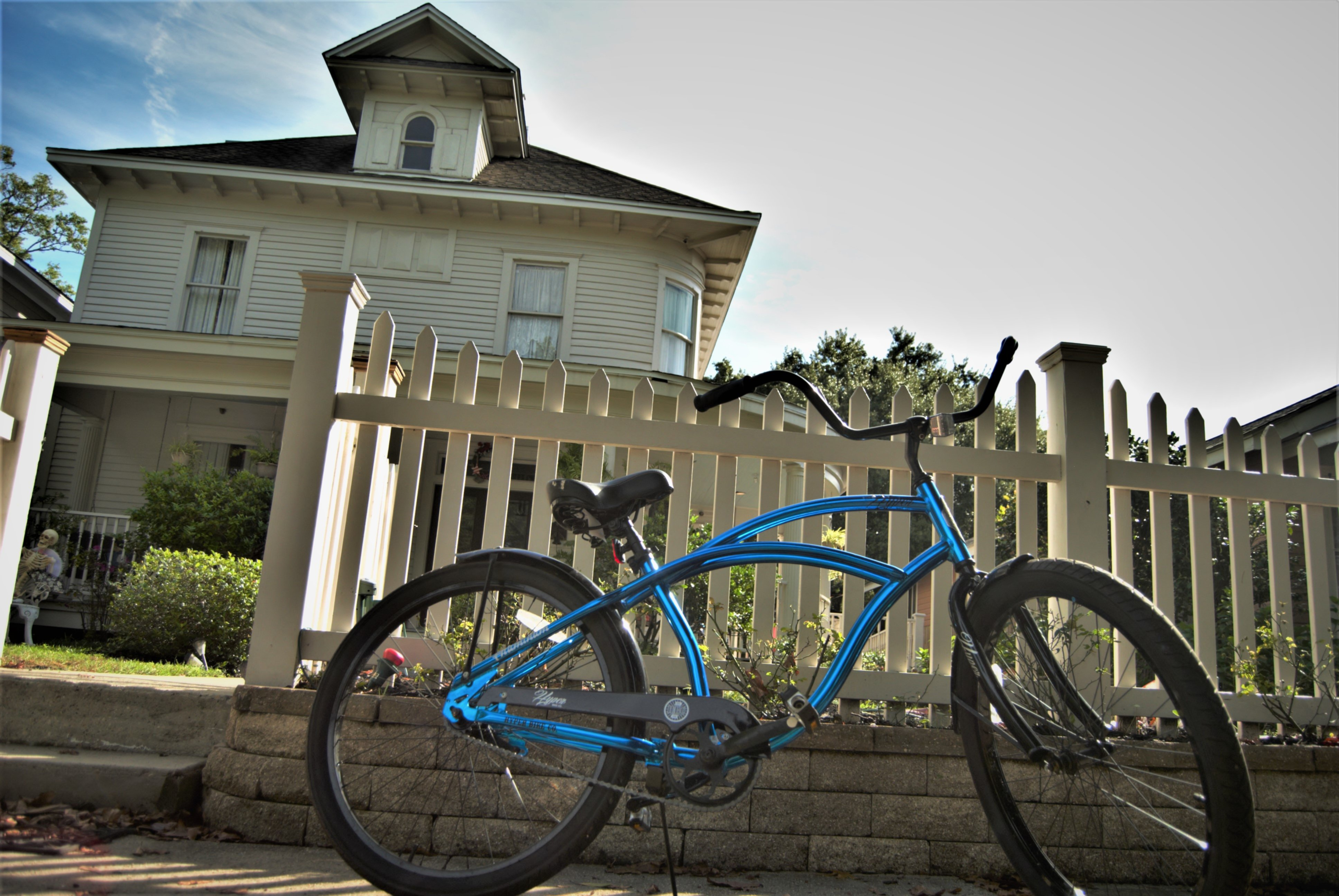 A bicycle parked in front of a building at The Guest House at Gulfport Landing.