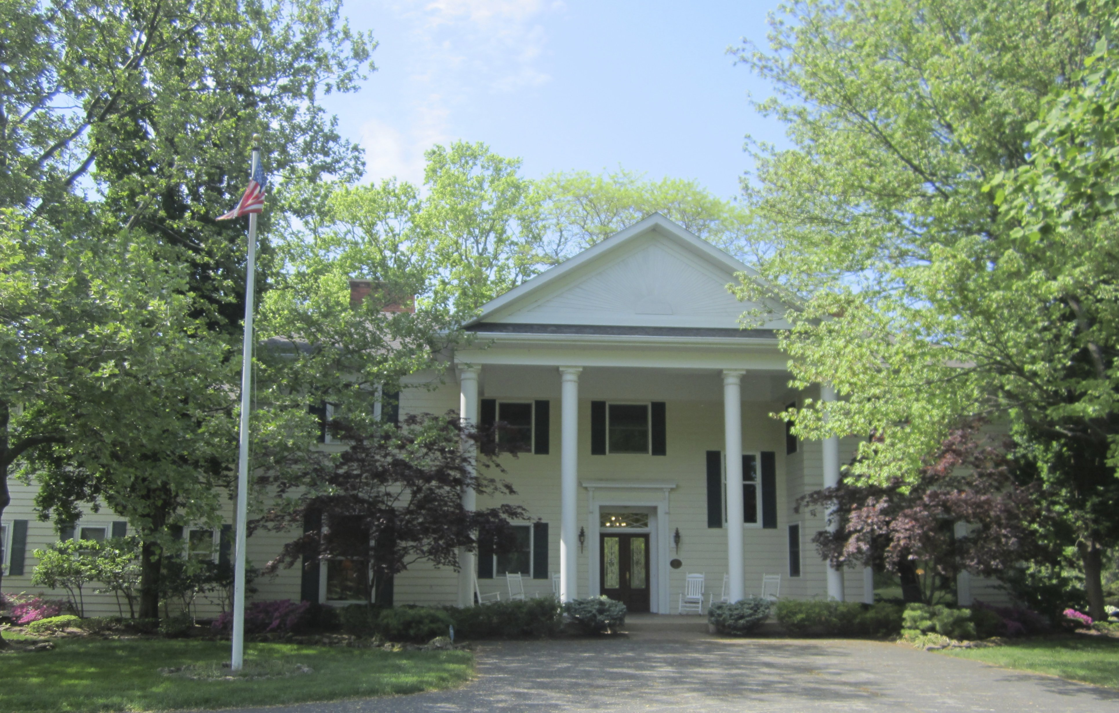 A tree in front of a house at Farrell House Lodge at Sunnybrook Trout Club.