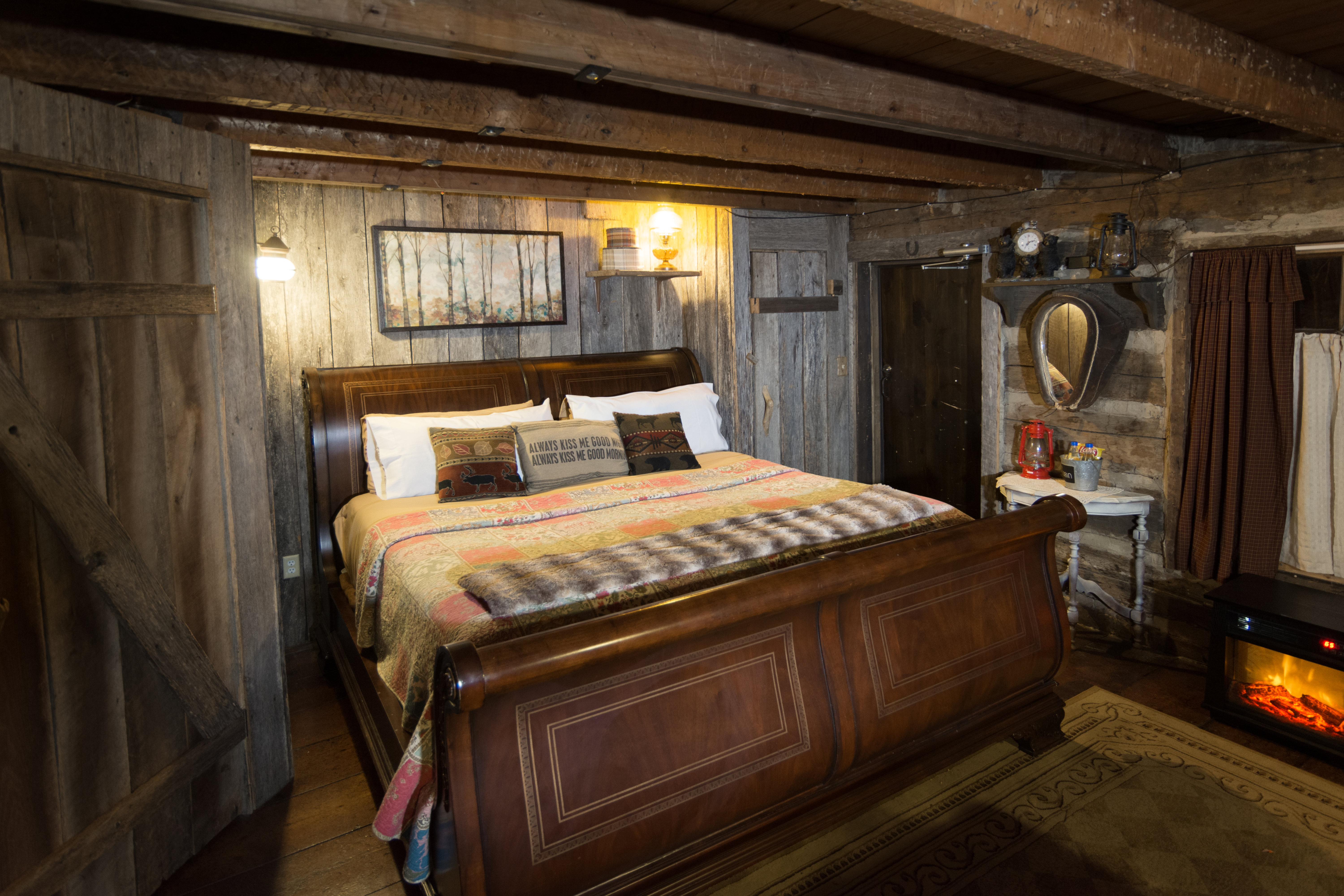 A bedroom with a bed and a fireplace at The Olde Mill Inn Bed & Breakfast.