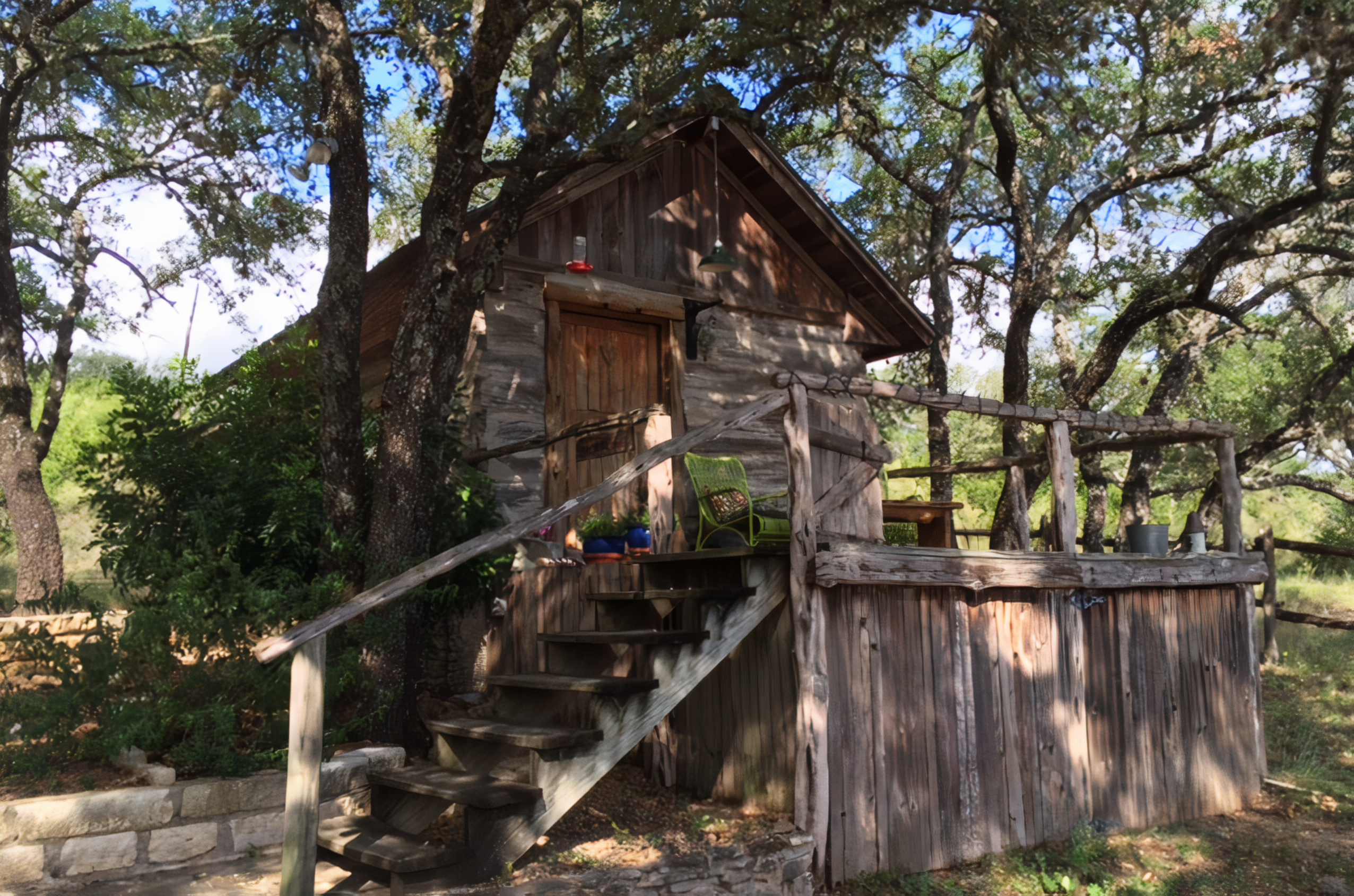 A house with a wooden fence at Chanticleer Log Cabin Bed & Breakfast.