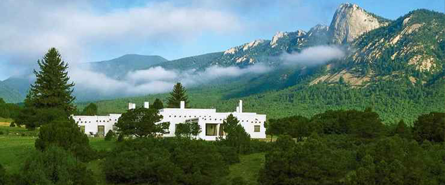 A castle with a mountain in the background at Casa del Gavilan Historic Inn.